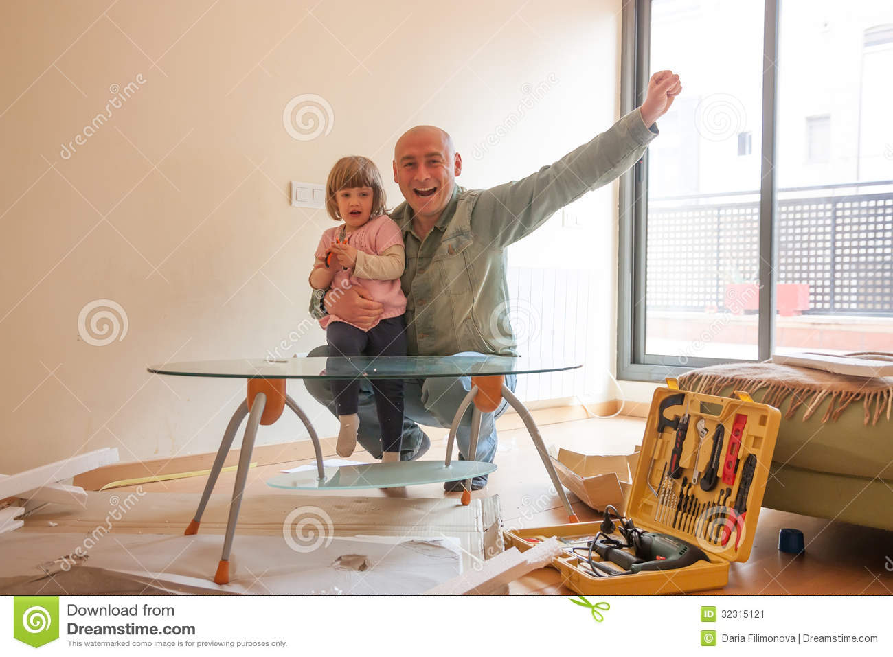 Dad and daughter renovating coffee table