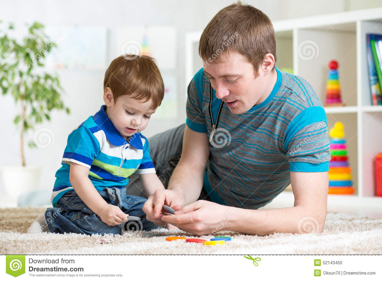 Boy Toys For Dads : Dad and kid playing toys at home stock photo image
