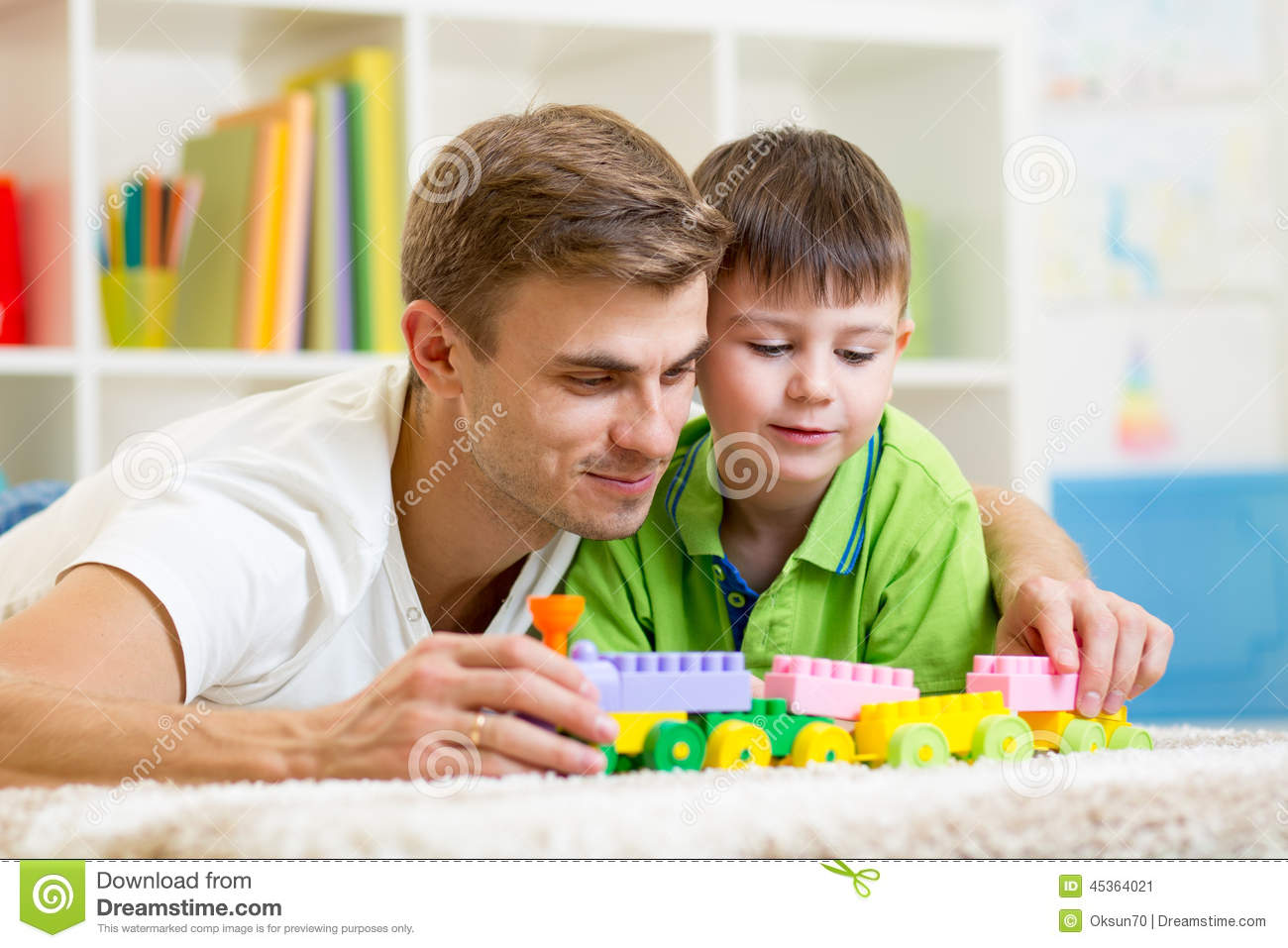 Dad with kid son play together