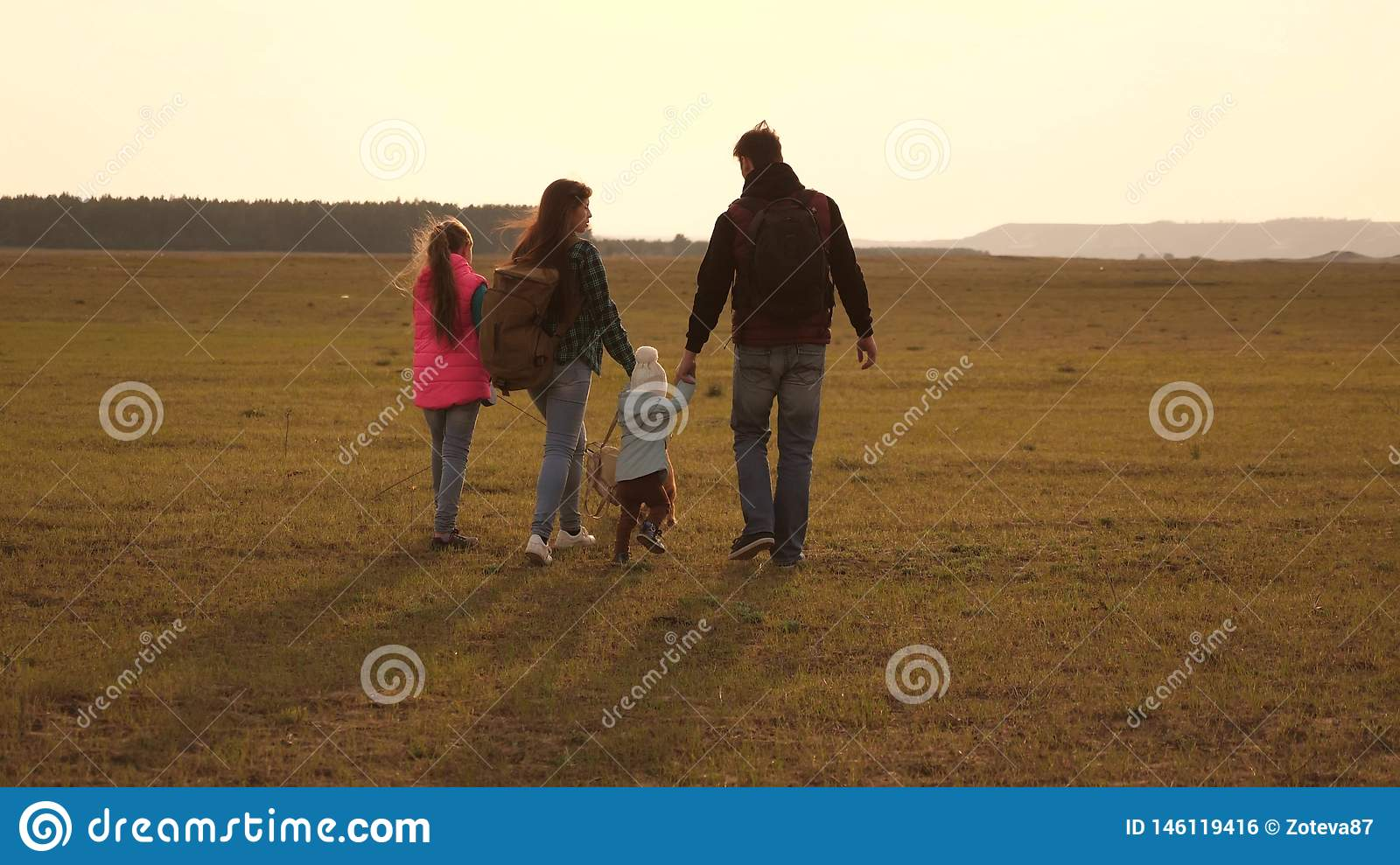 Dad, mom, daughters and pets, tourists. teamwork of a close-knit family. the family travels with the dog across the