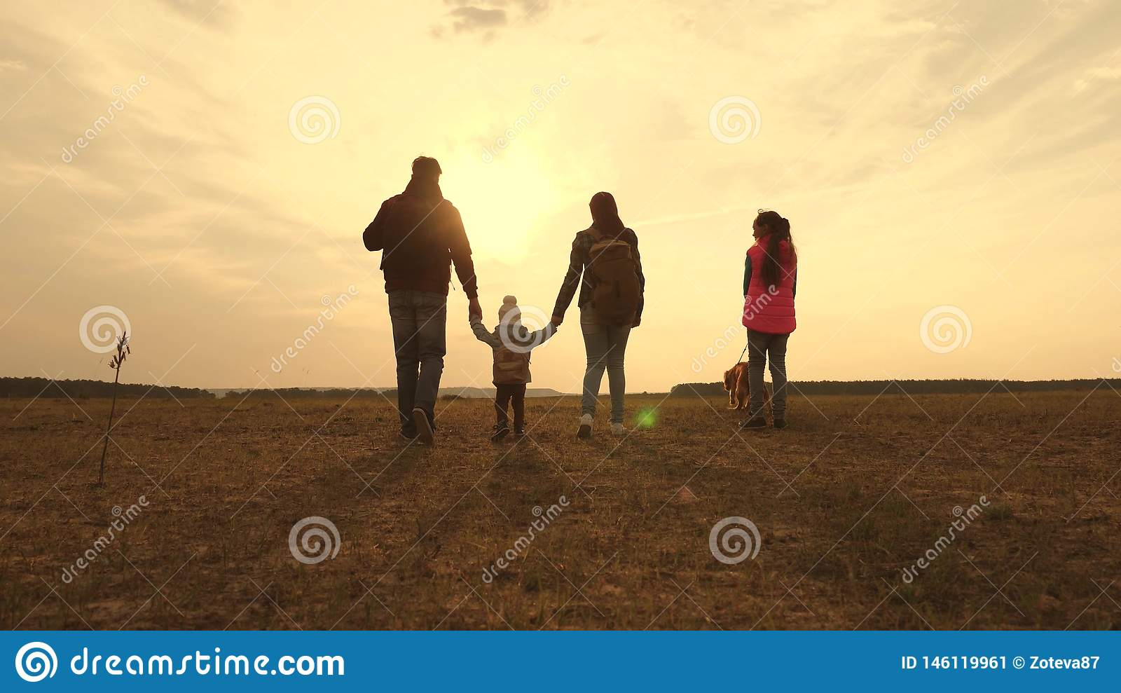 Dad, Mom, a small child and daughters and pets tourists. teamwork of a close-knit family. family travels with the dog on
