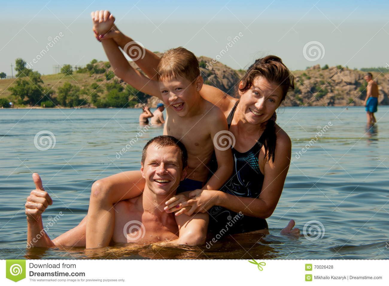 Dad Mom And Son Swimming In The River Son Bathing In The River With His Jpg