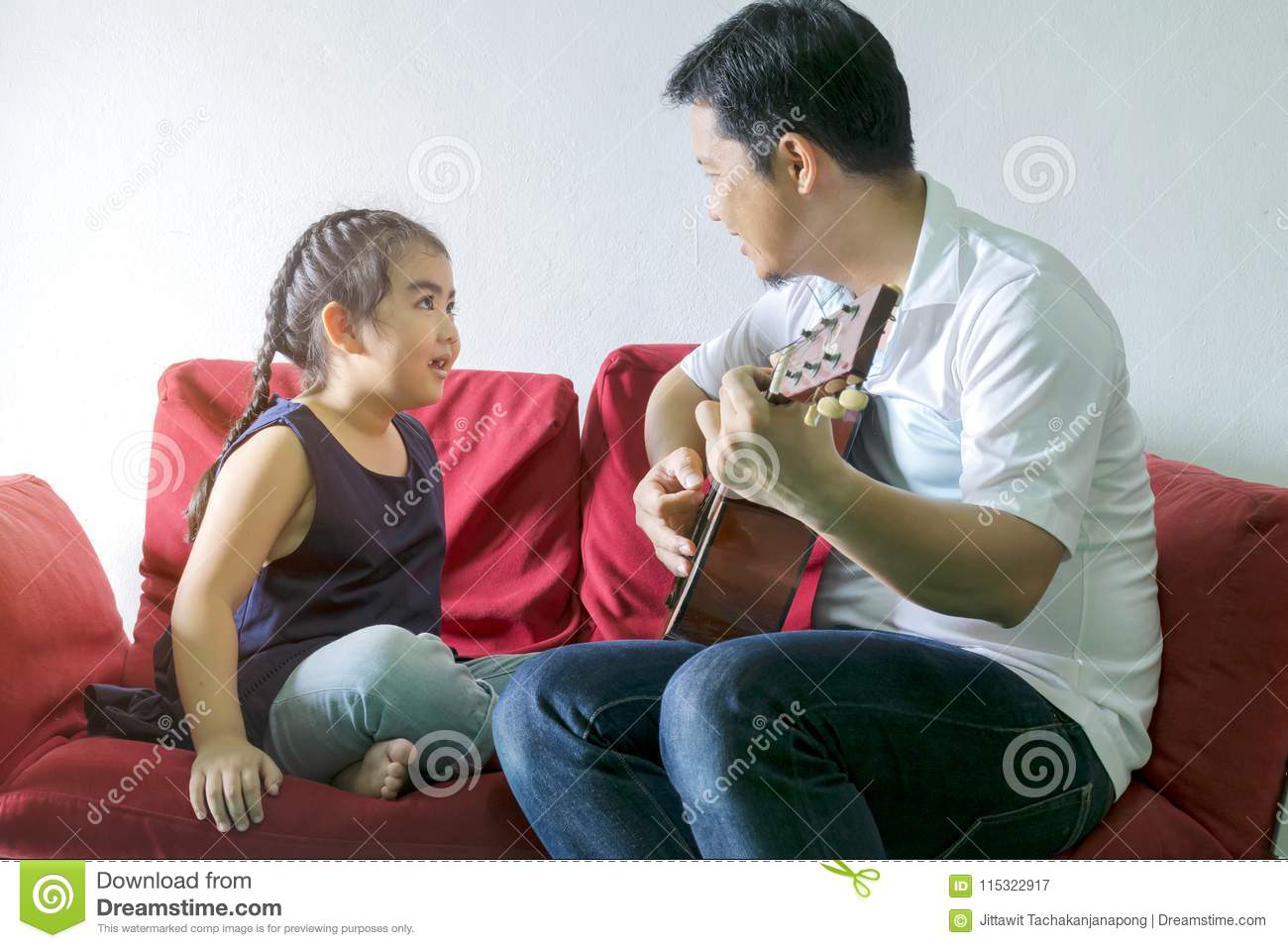Dad playing guitar and a song with a girl.