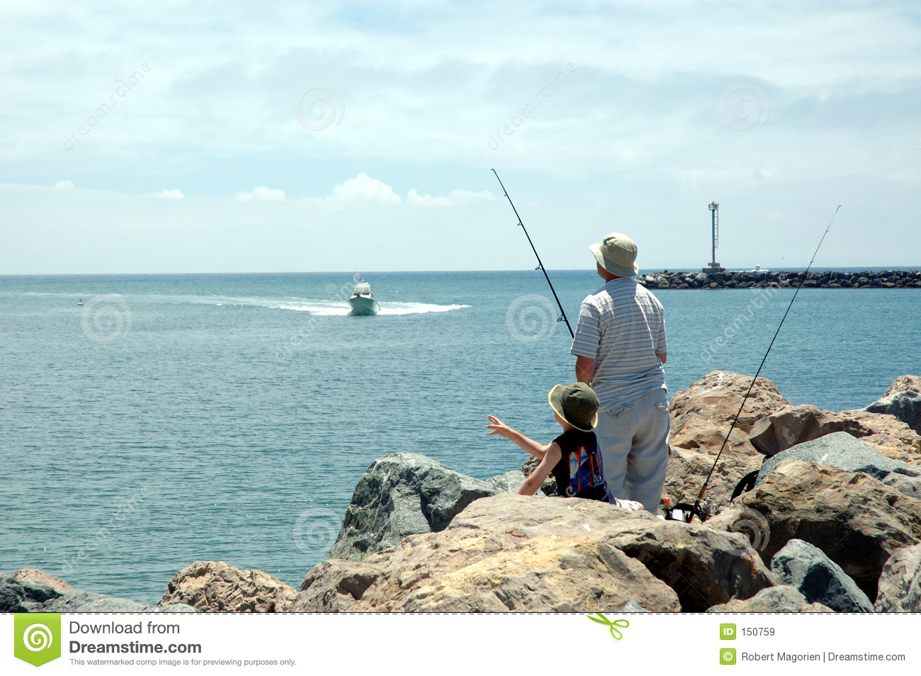 Dad and son 1 fishing at beach