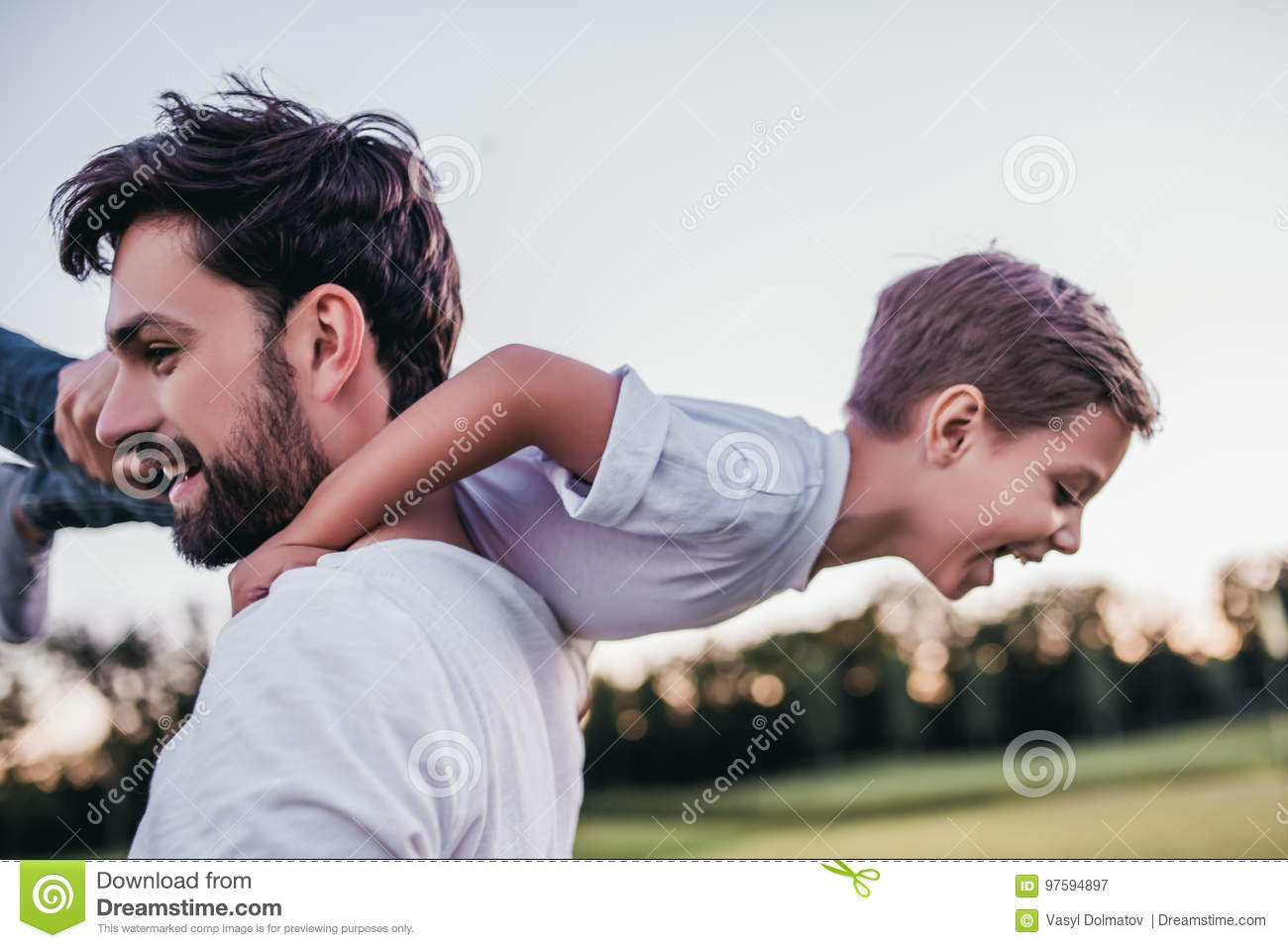 Dad and son outdoors