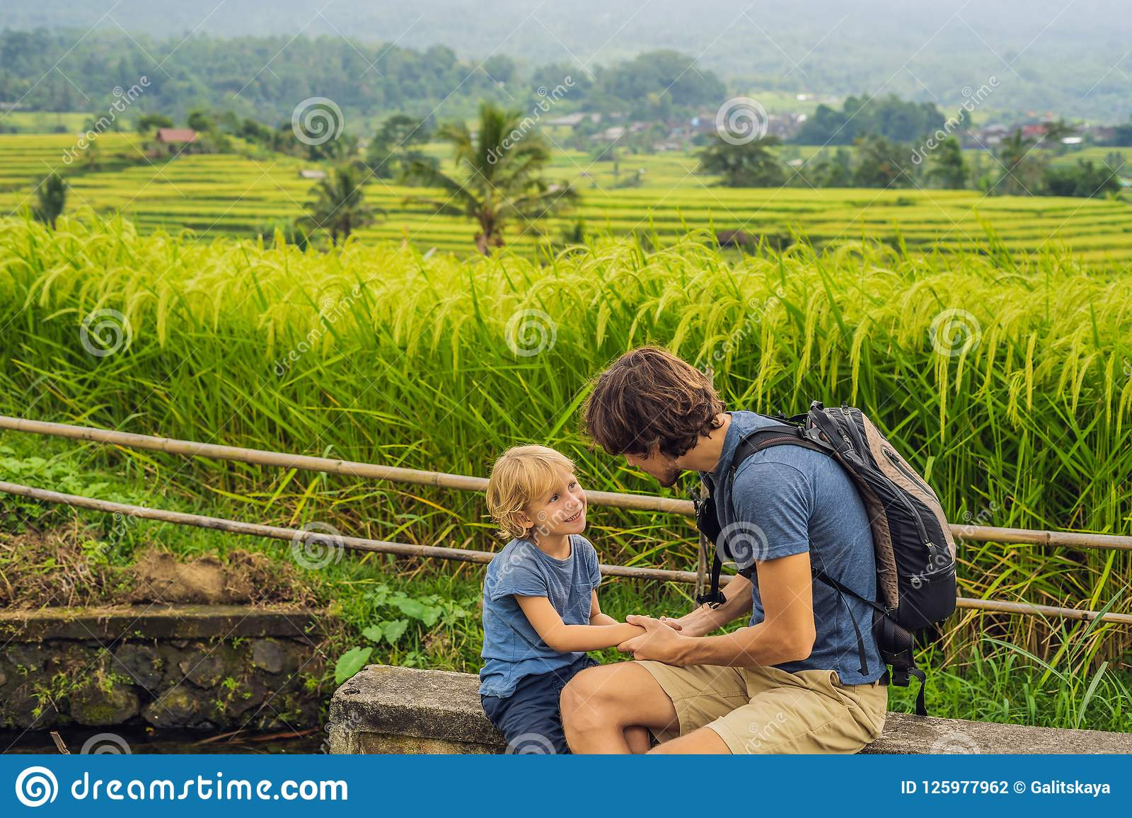 Dad And Son Travelers On Beautiful Jatiluwih Rice Terraces