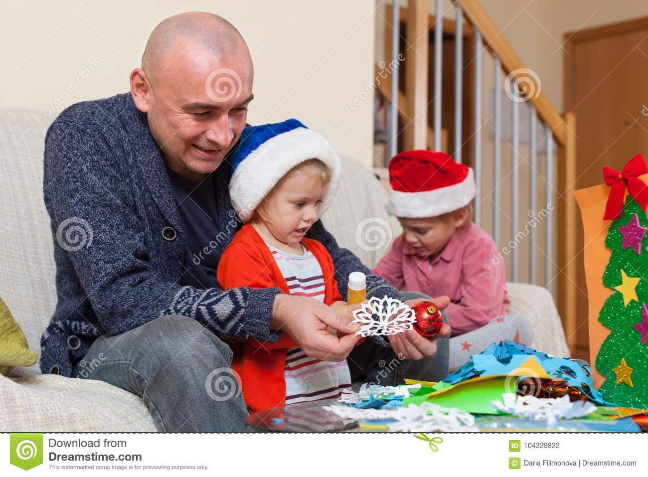 Dad with two daughters making crafts