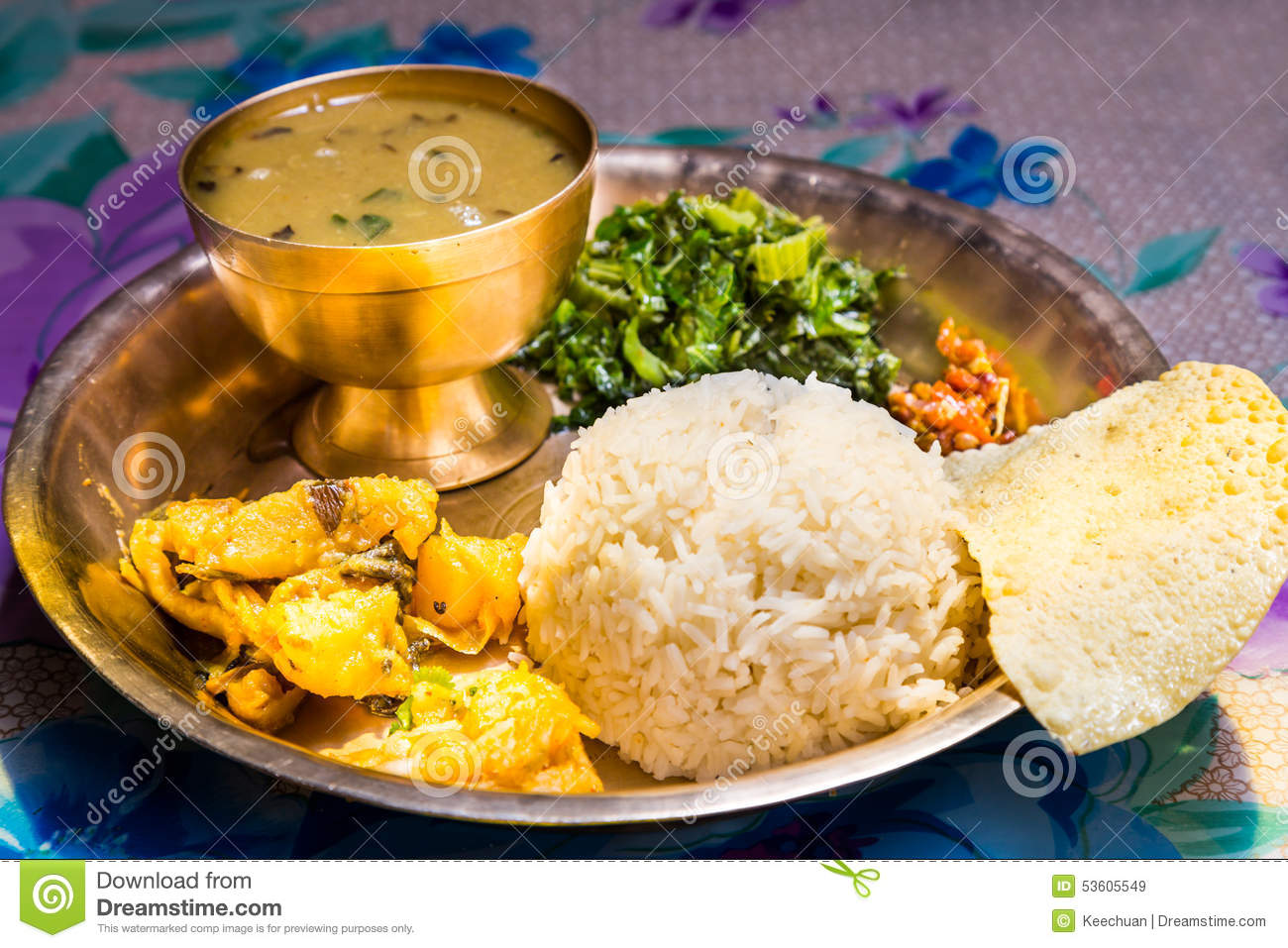 Dal Bhat, traditional Nepali meal platter with rice, lentils soup, vegetables, papadum and spices