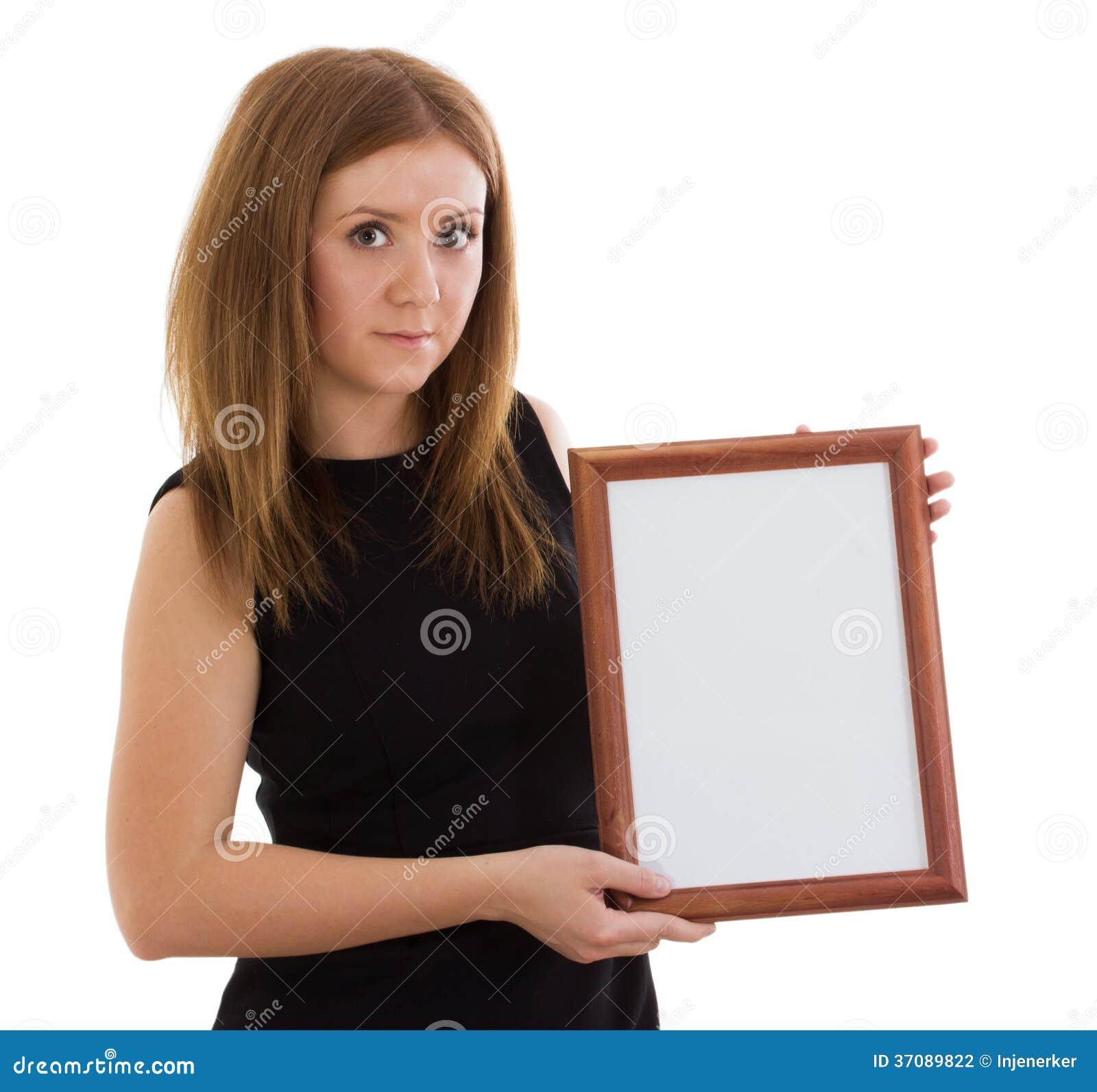 Download Dama trzyma drewnianą ramę zdjęcie stock. Obraz złożonej z kardamon - 37089822