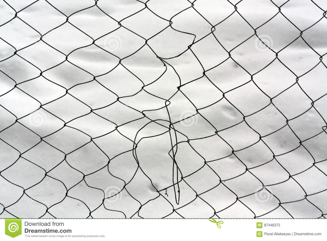 Damaged Mesh Wire Fence Against Snow. Stock Image - Image of ...