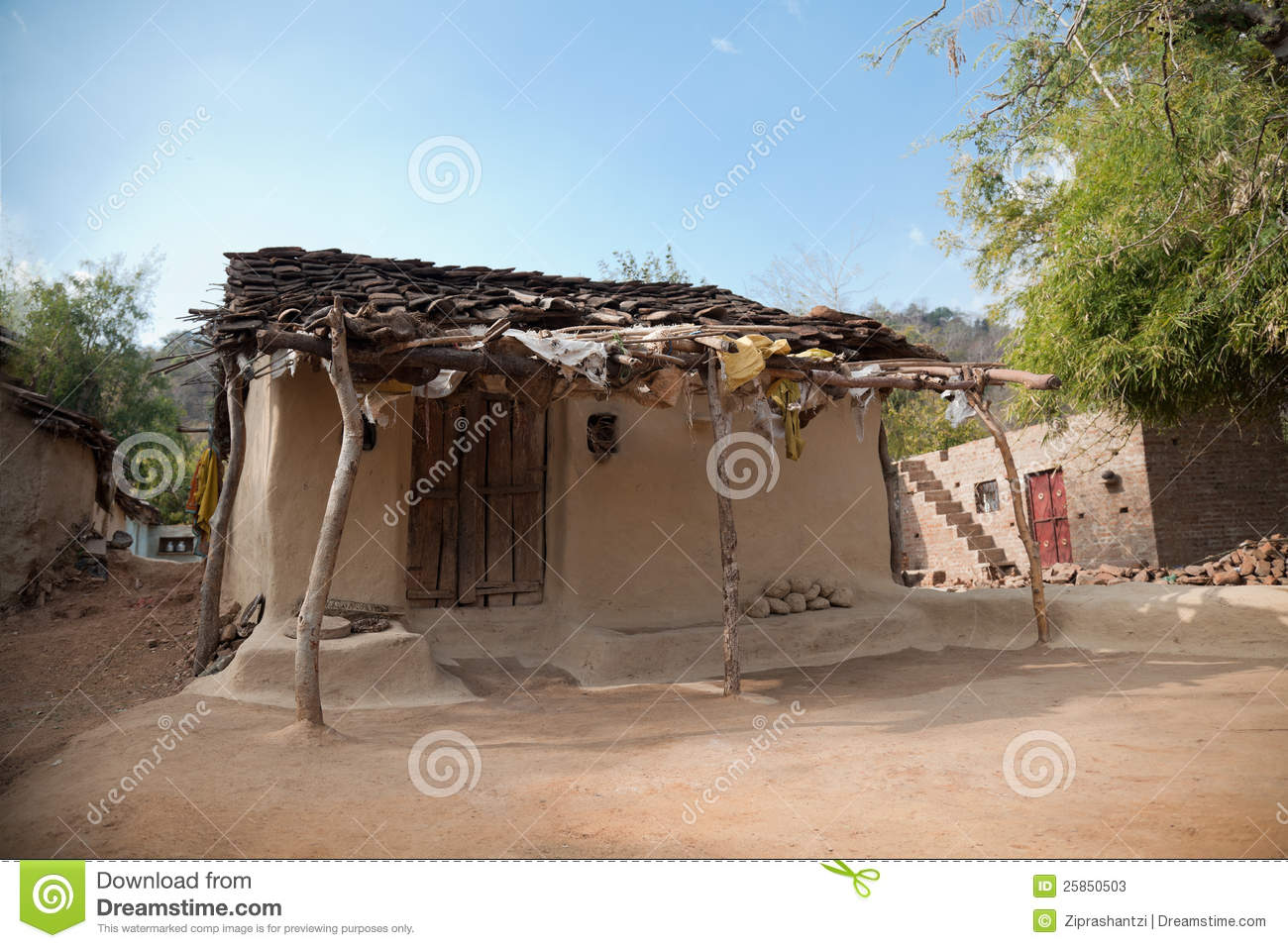 Damaged old house in village of india made of soil.