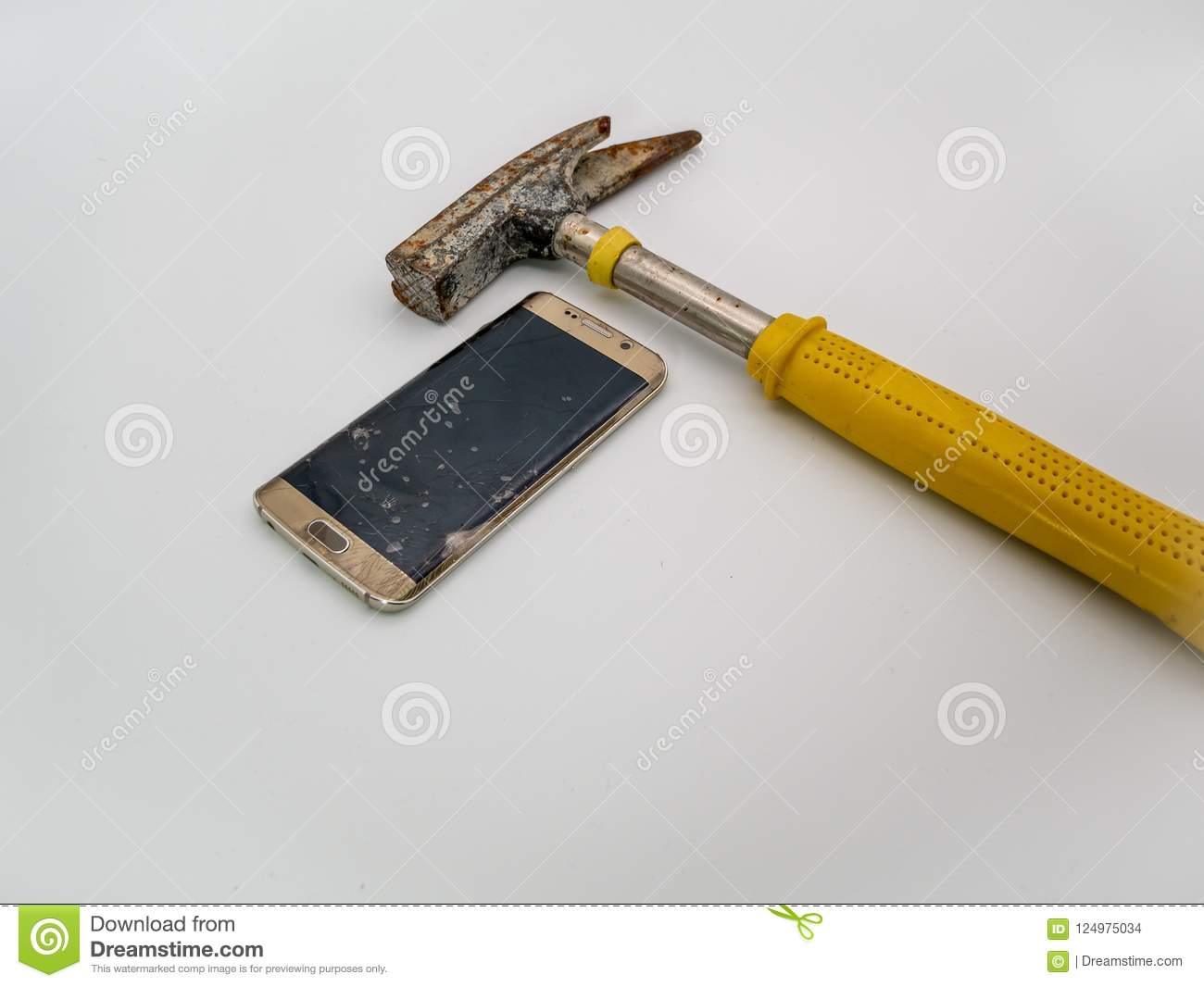 Damaged smartphone disply with hammer and white background