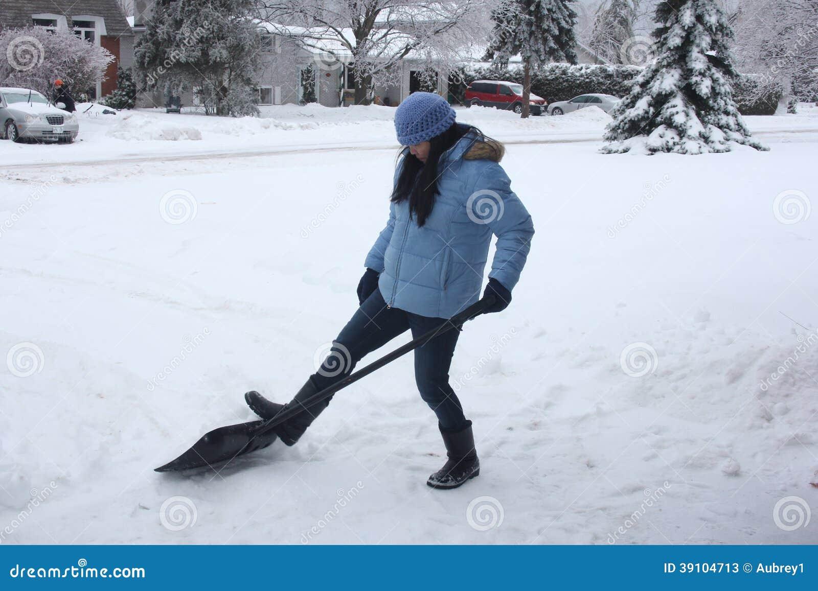 Dame Shoveling Snow