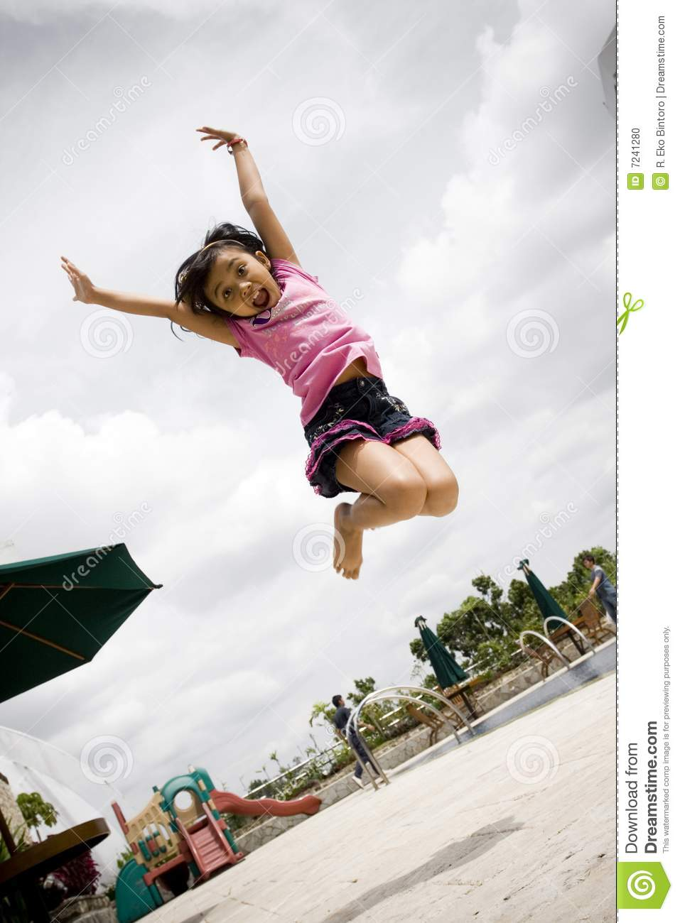 Asian little girl doing dance jump with style.