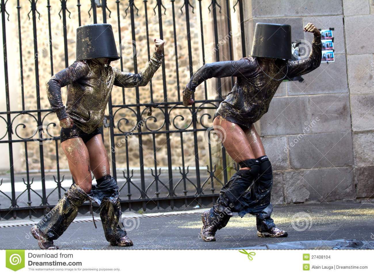 Dancers with buckets on the head.