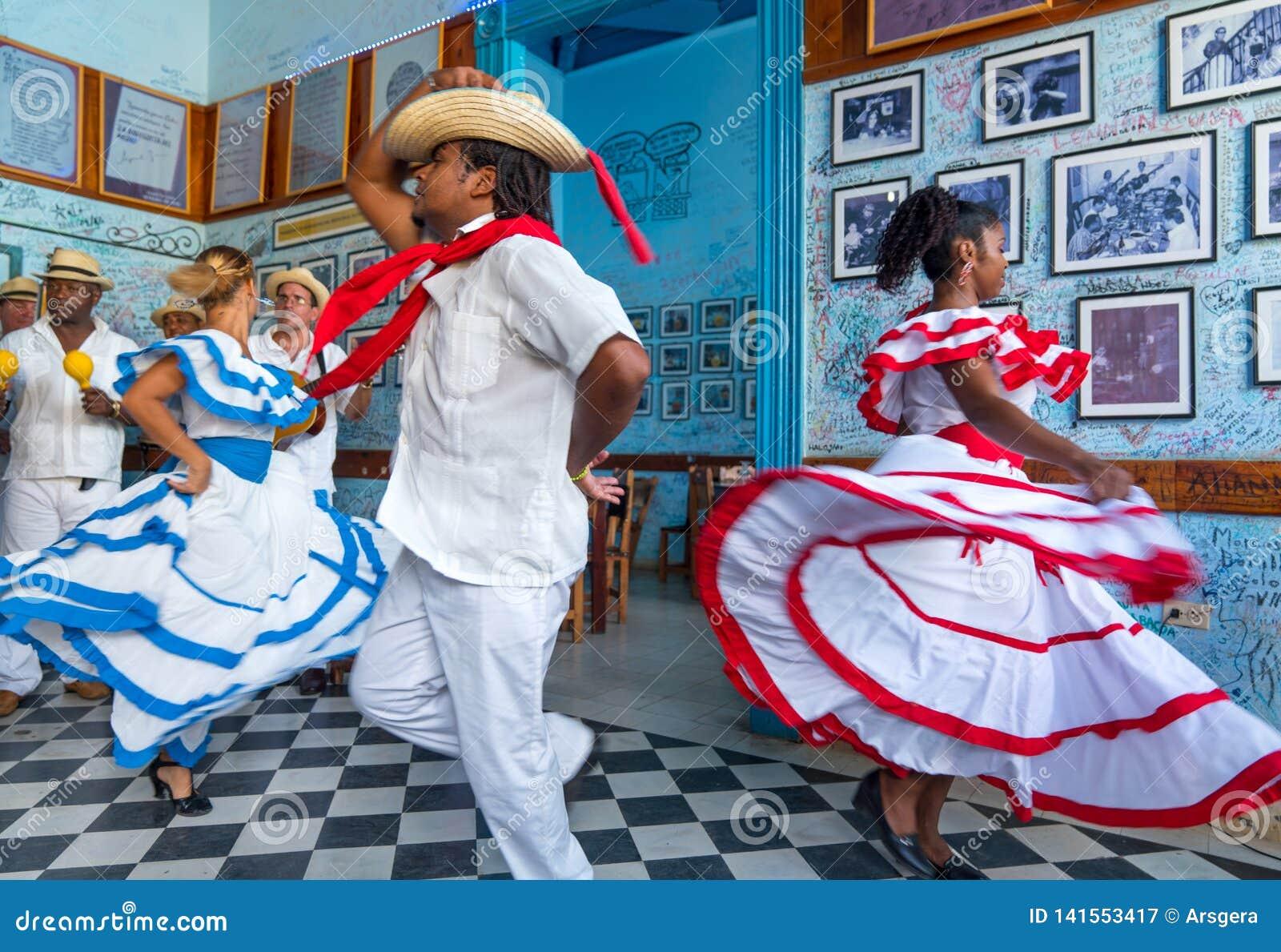 Dancers and musicians perform cuban folk dance