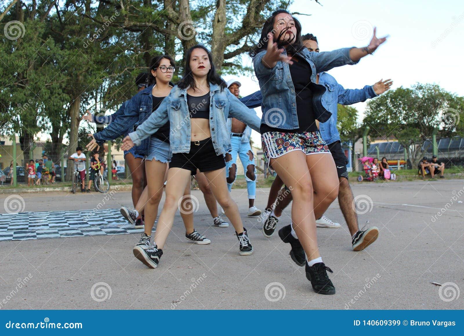 Dancers performing an outdoor street dance performance