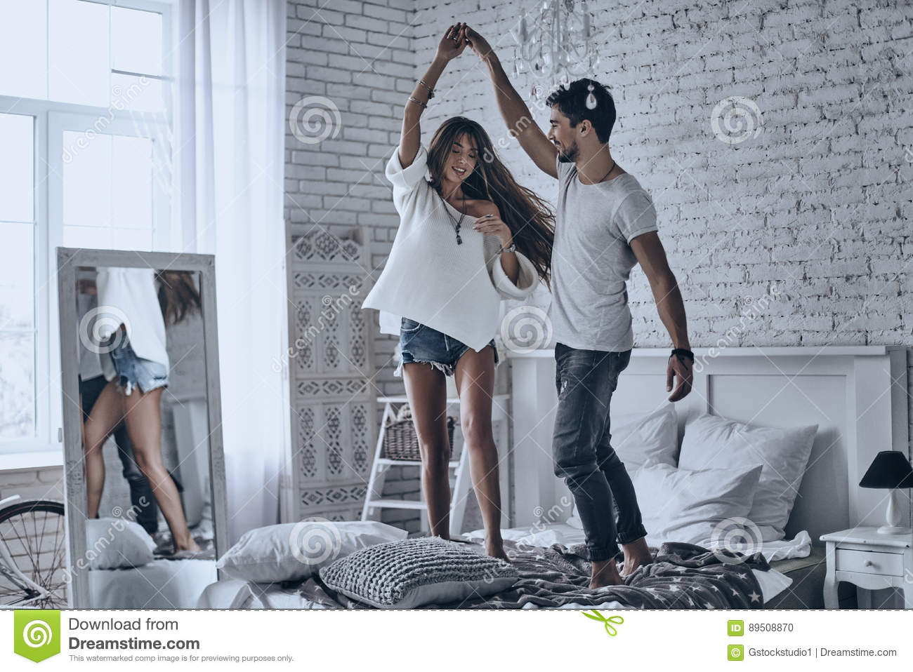 Dancing on the bed.