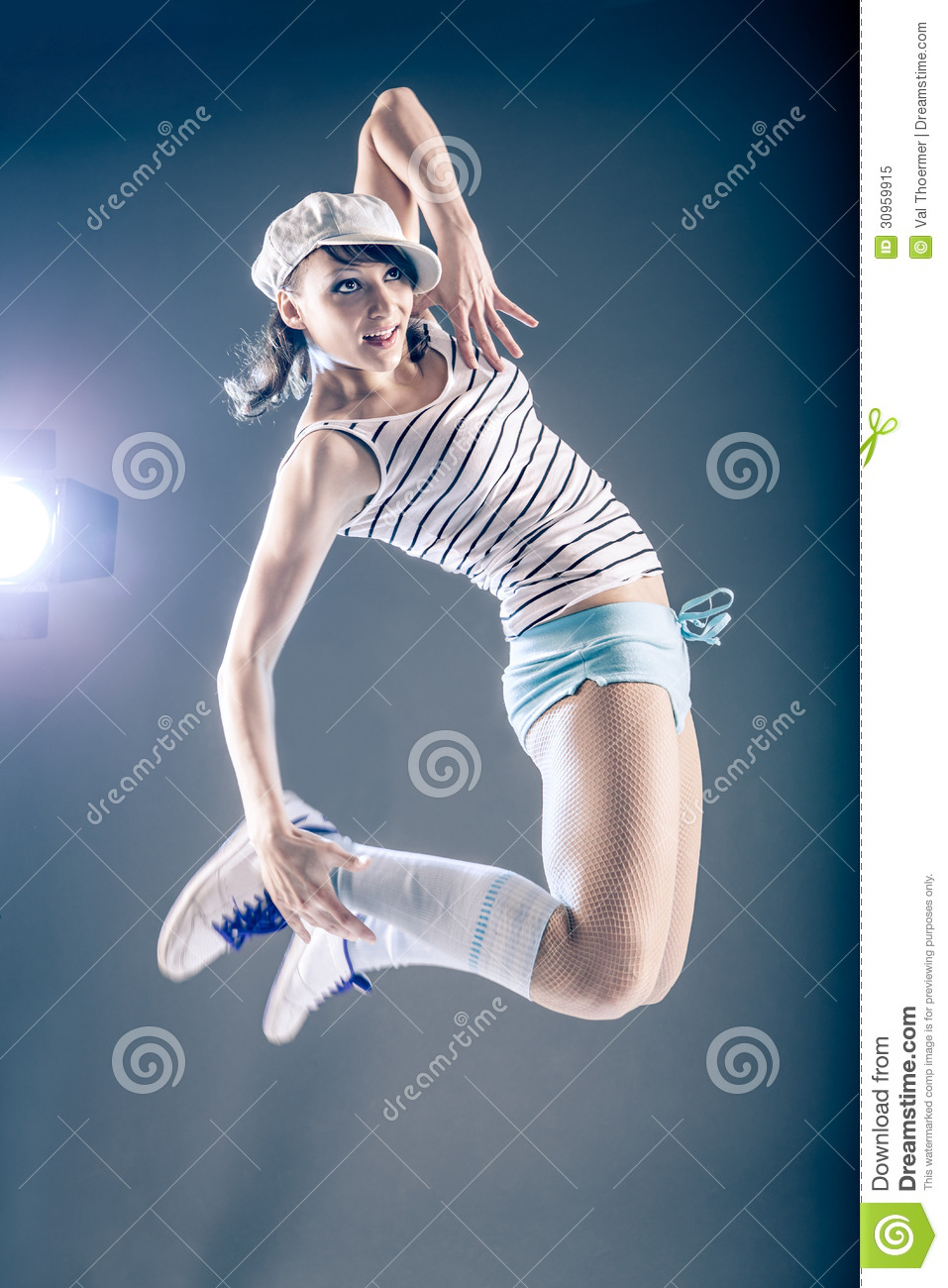 Young Woman In Sport Dress Dancing In Zumba Or Reggaeton Or Hiphop
