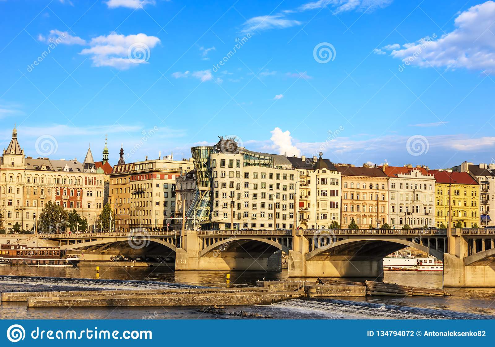 Dancing House in Prague and Jirasek Bridge bridge over the Vltava