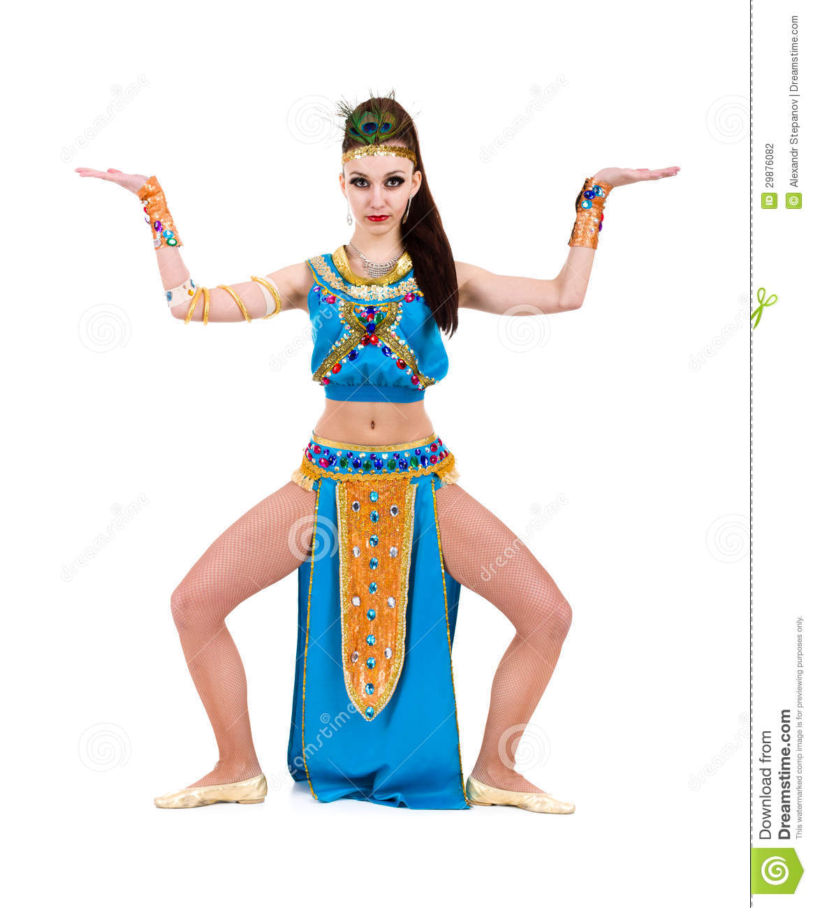 Dancing pharaoh woman wearing a egyptian costume. Isolated on white