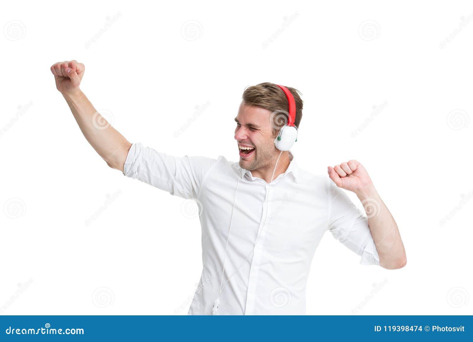 Dancingowa muzyka Obsługuje słuchającą ulubioną piosenkę w hełmofonach i tanu Mężczyzna szczęśliwa twarz cieszy się słuchającego