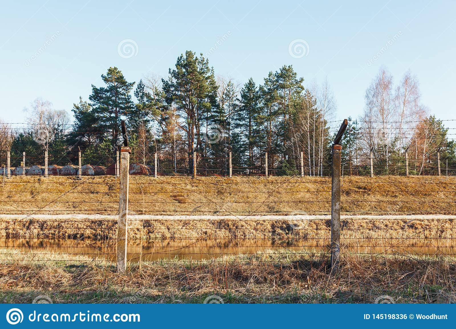 Dangerous area fenced with barbed wire fence