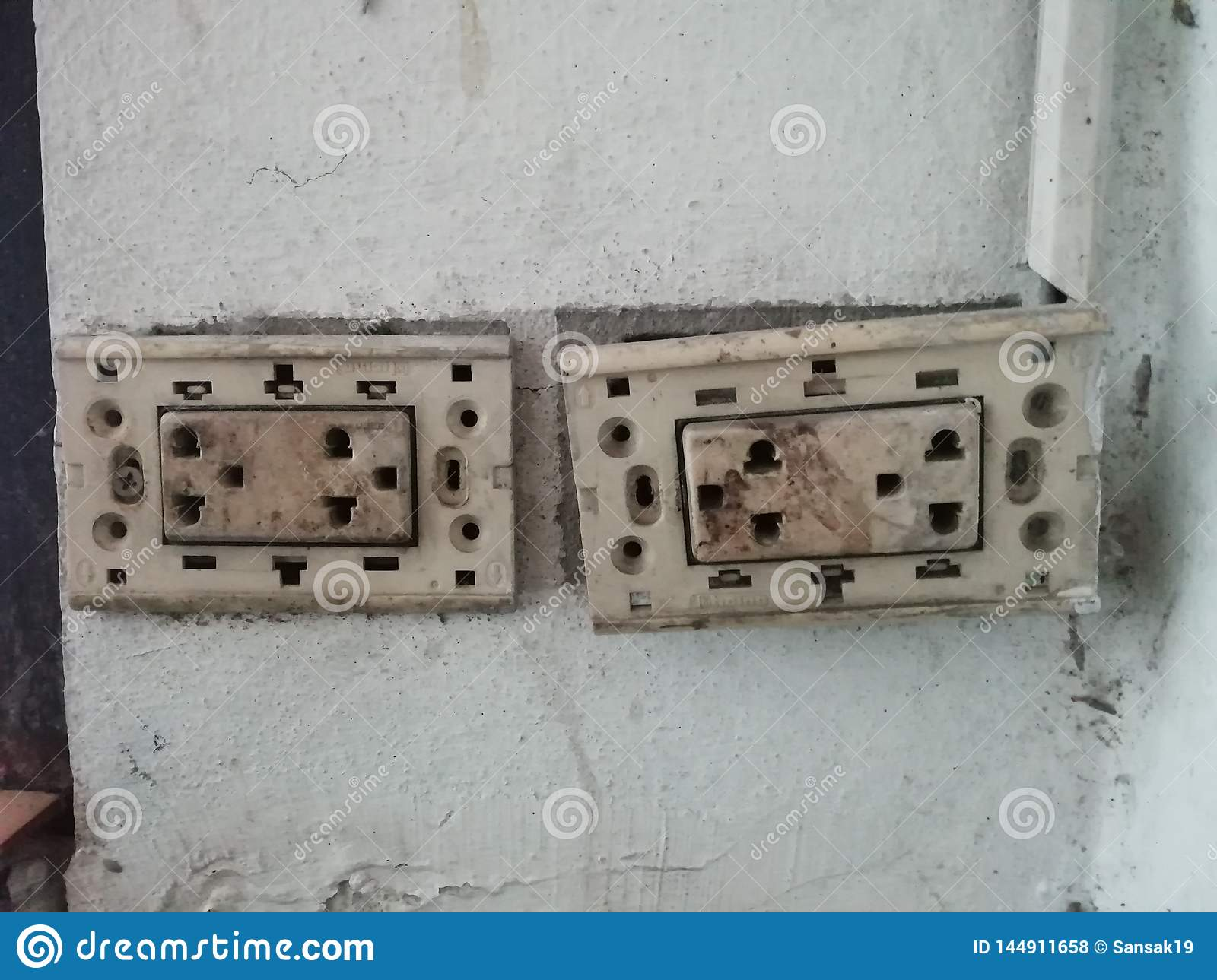 Broken Plug On White Wall, Defective Power Plugs, Electrical Safety