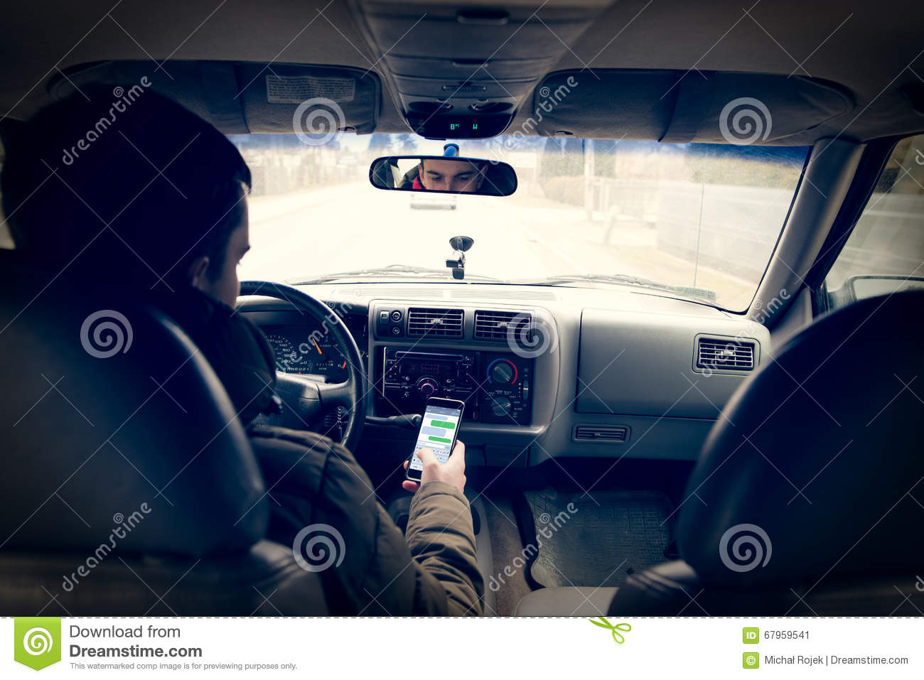 Dangerous driving while writing SMS