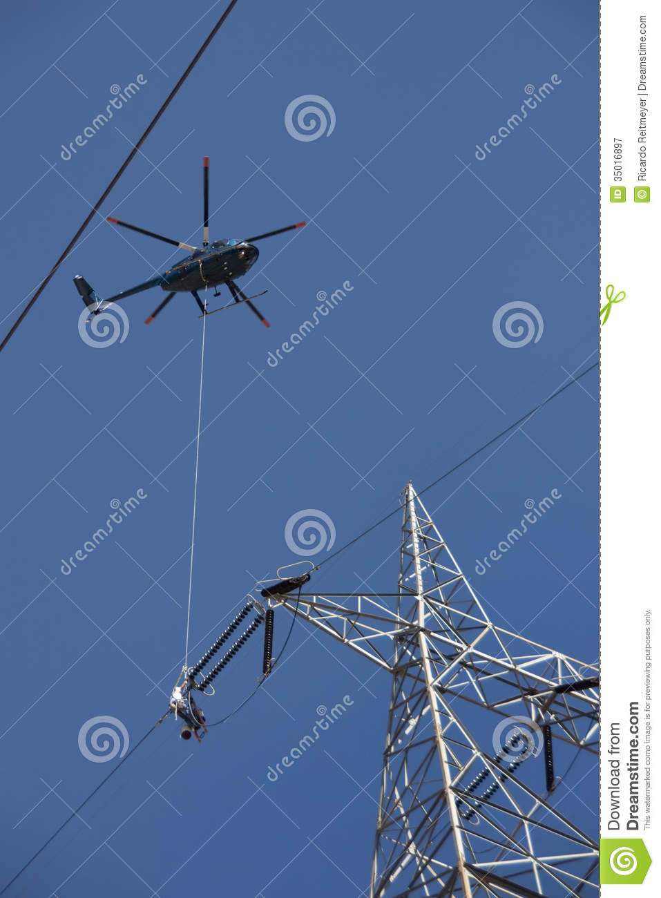 High Voltage Power Lines : Dangerous high voltage power line work from a helicopter