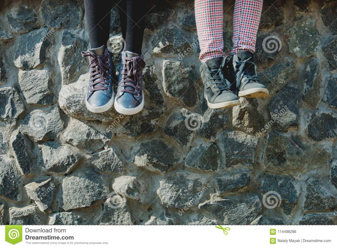 Dangling baby girl`s feet in shoes