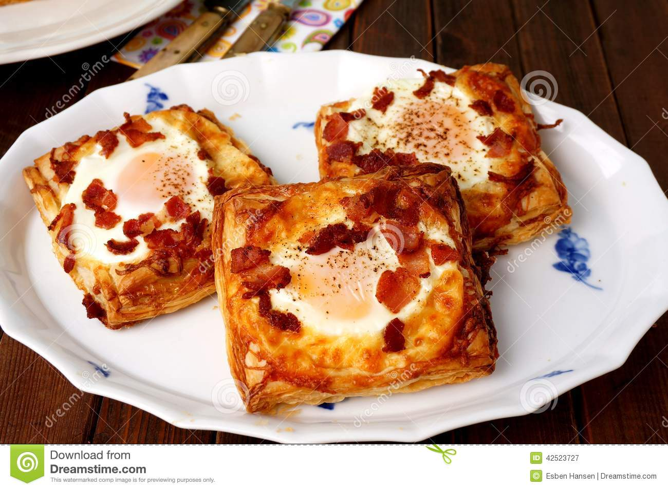 Danish pastries, breakfast with egg, bacon, cheese and puff pastries
