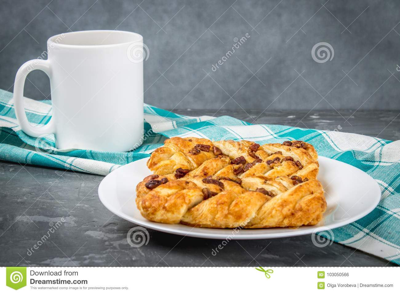 Danish pastry maple pecan with nuts and maple syrup.