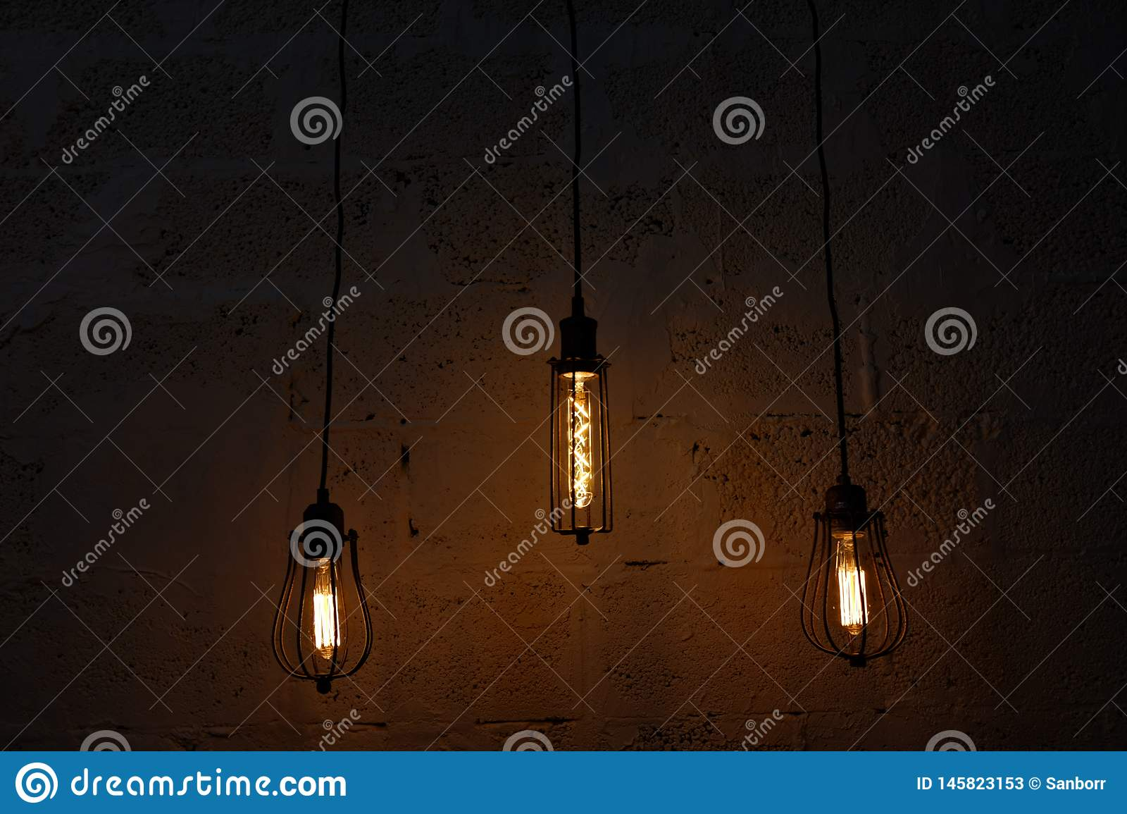 Dark background with glass retro-bulb Edison. Wallpapers with designer lamp of Edison. Designer light and lighting in interiors.