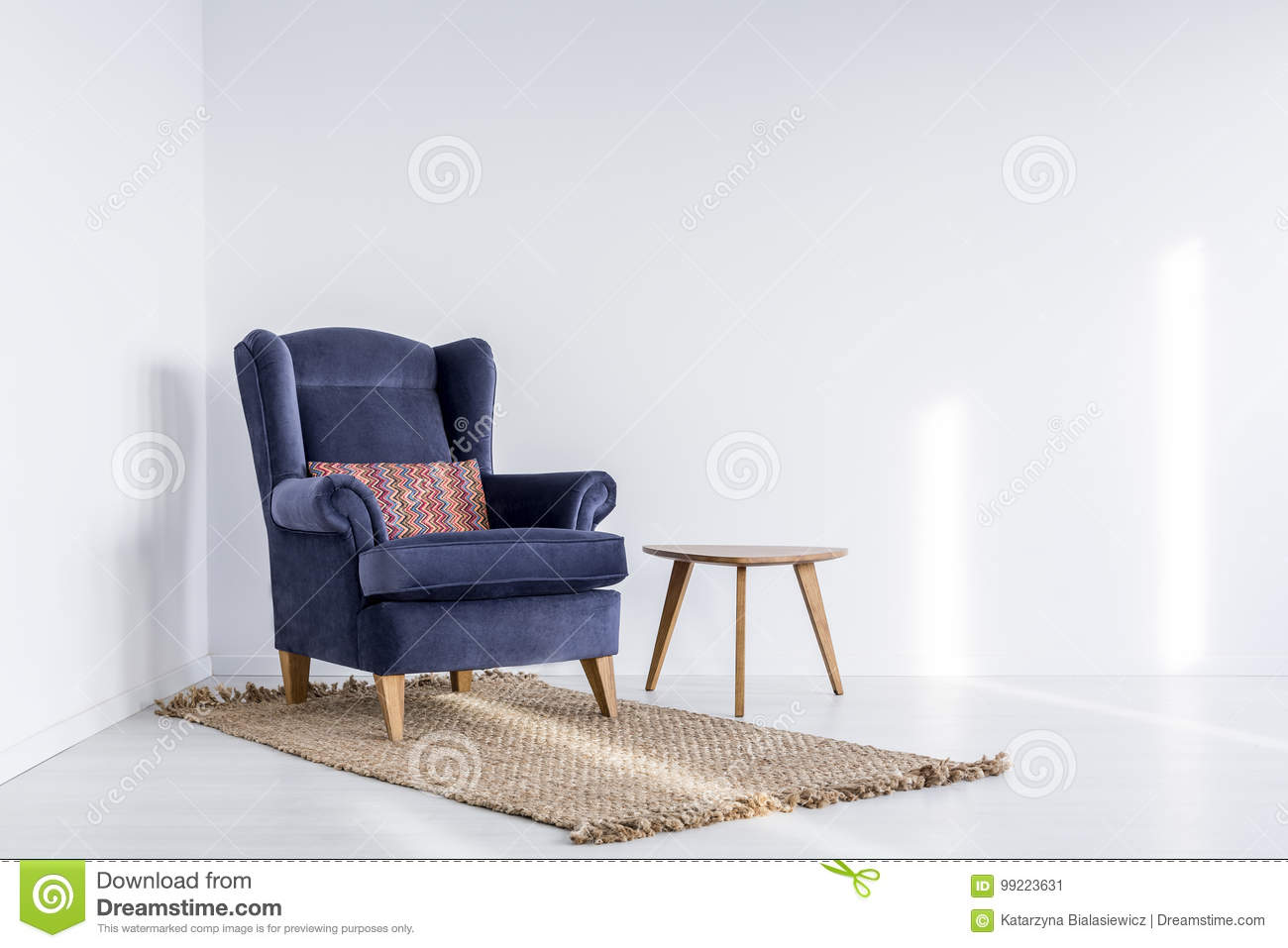 Dark blue armchair on brown carpet
