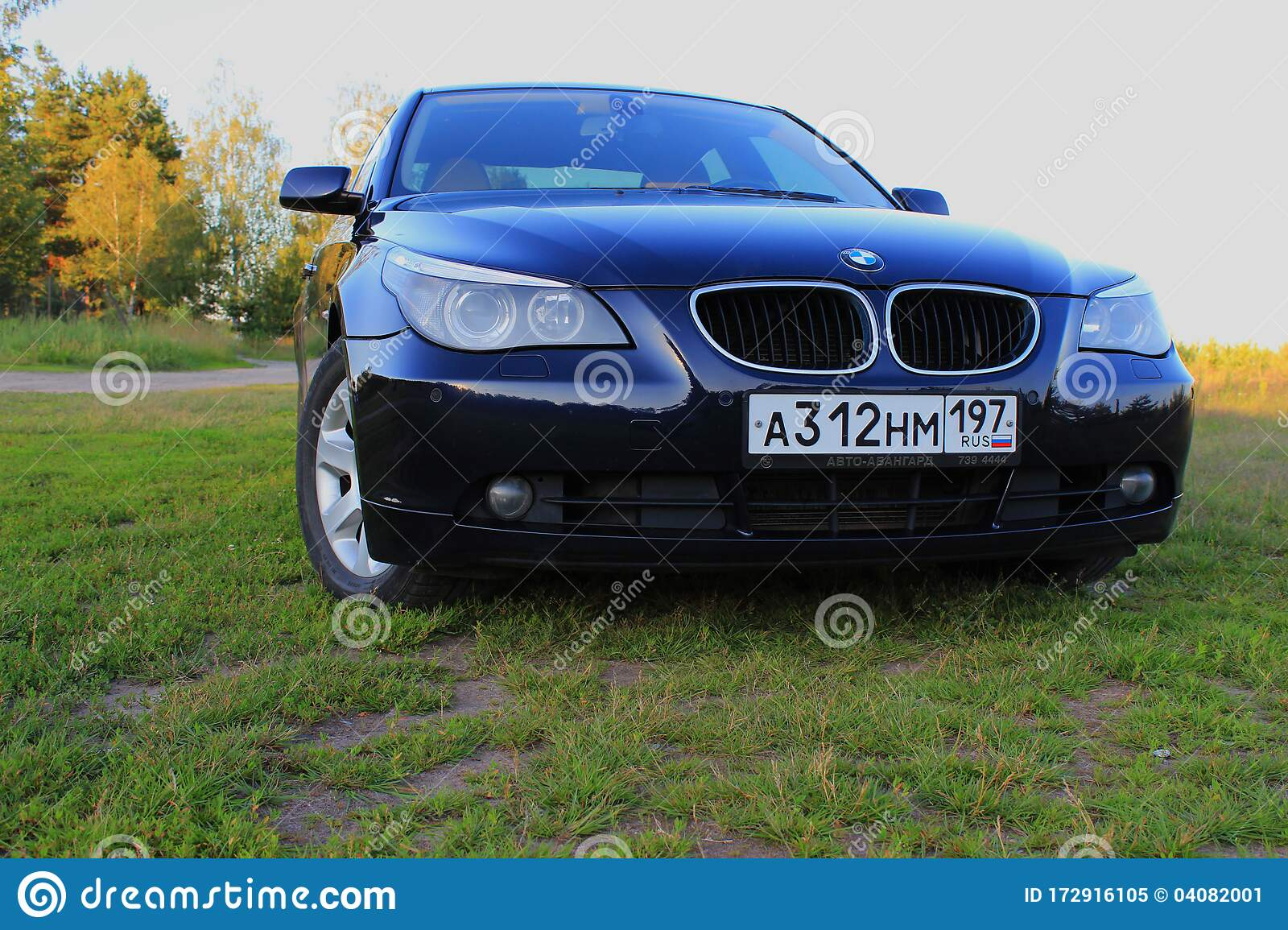 Dark Blue Bmw 5 Series E60 On A Sunny Summer Day In A Clearing With Green Grass Editorial Image Image Of Classic Street 172916105