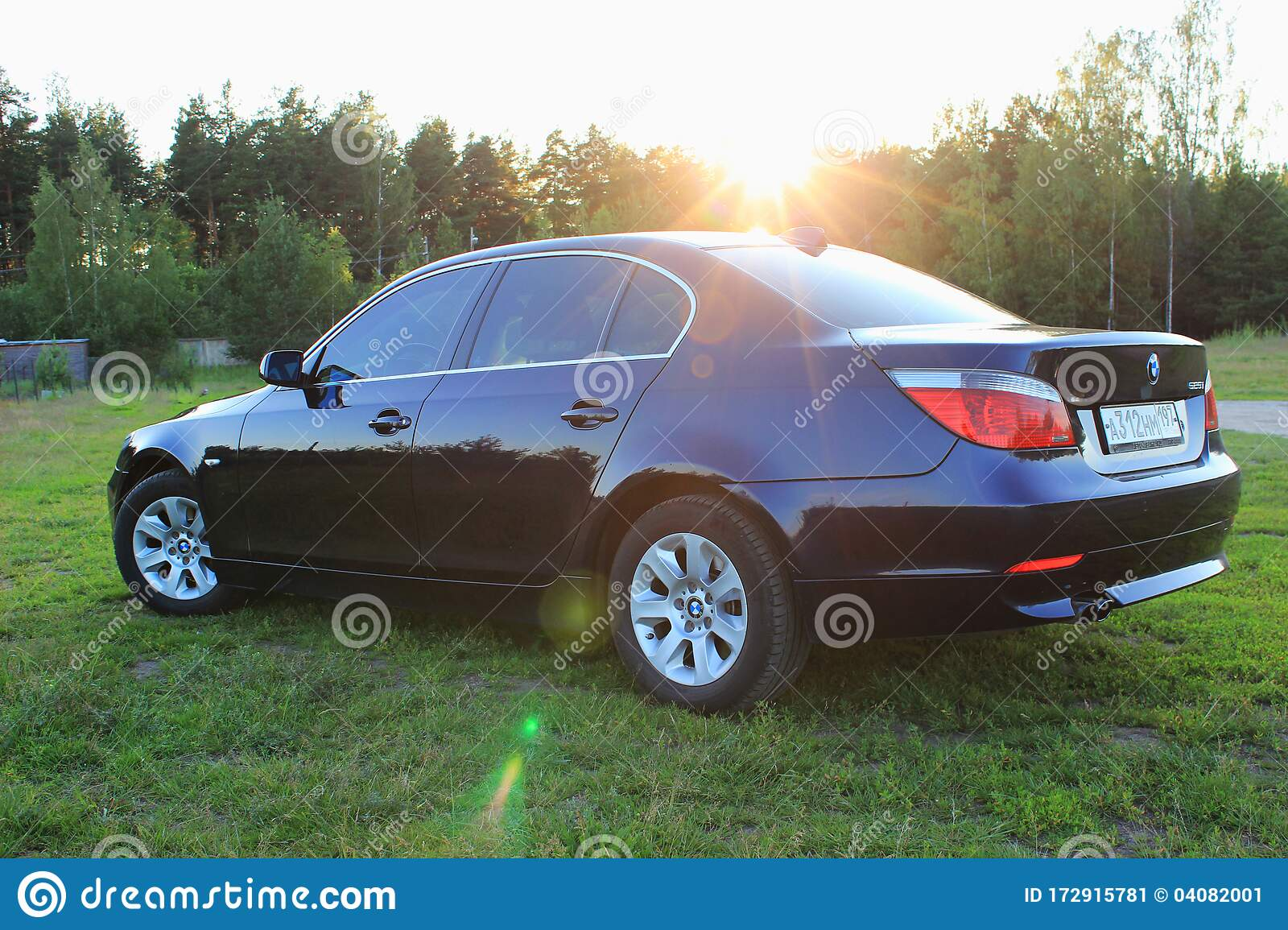 Dark Blue Bmw 5 Series E60 On A Sunny Summer Day In A Clearing With Green Grass Editorial Photo Image Of Retro Automotive 172915781
