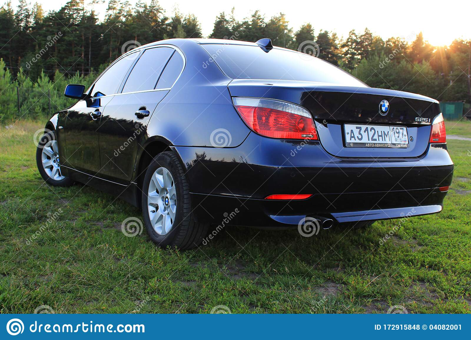 Dark Blue Bmw 5 Series E60 On A Sunny Summer Day In A Clearing With Green Grass Editorial Stock Photo Image Of Bavarian Automotive 172915848