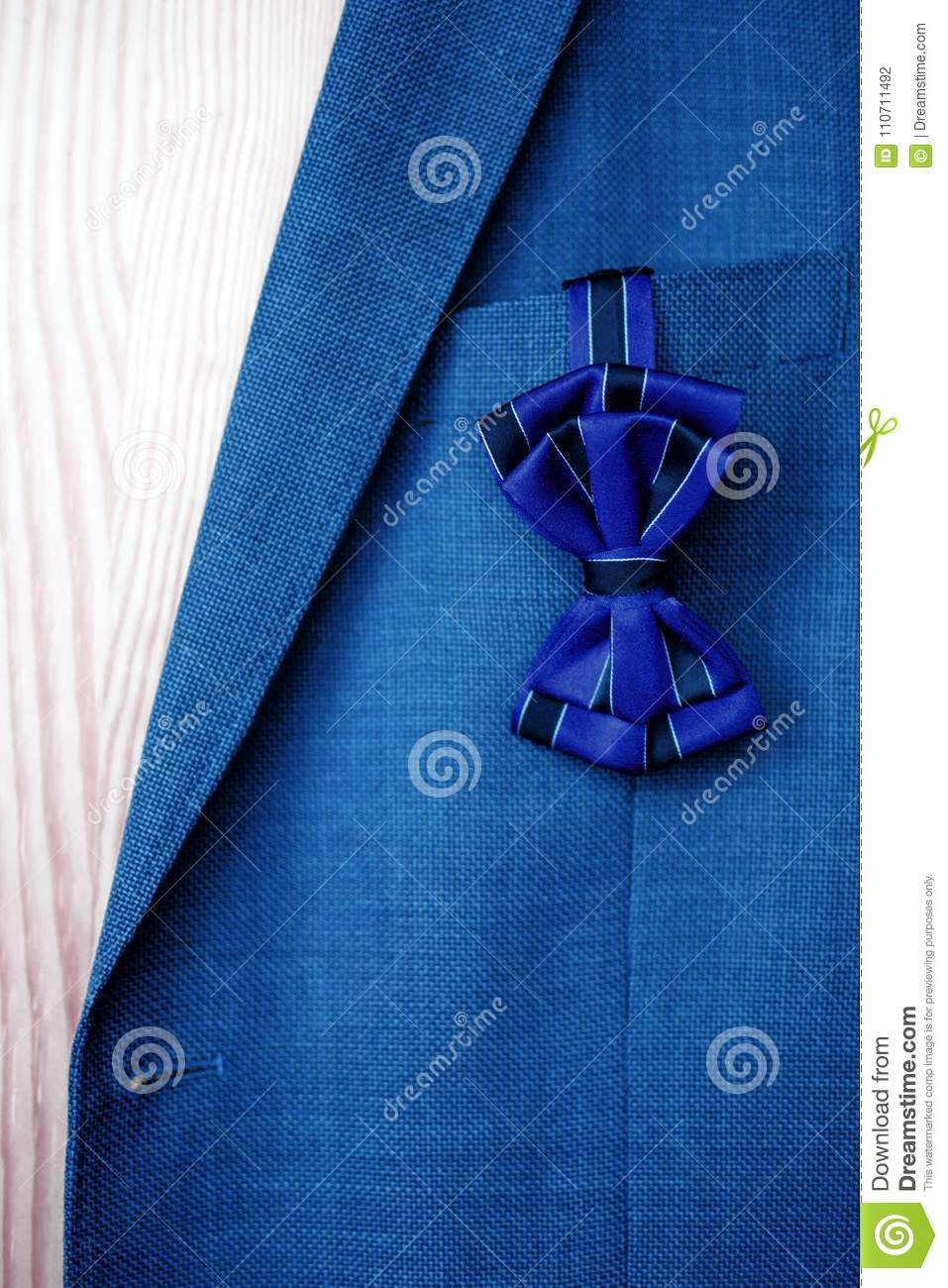 Dark blue bow tie with black stripes hanging out of blue suit royalty free stock photo biocorpaavc Image collections