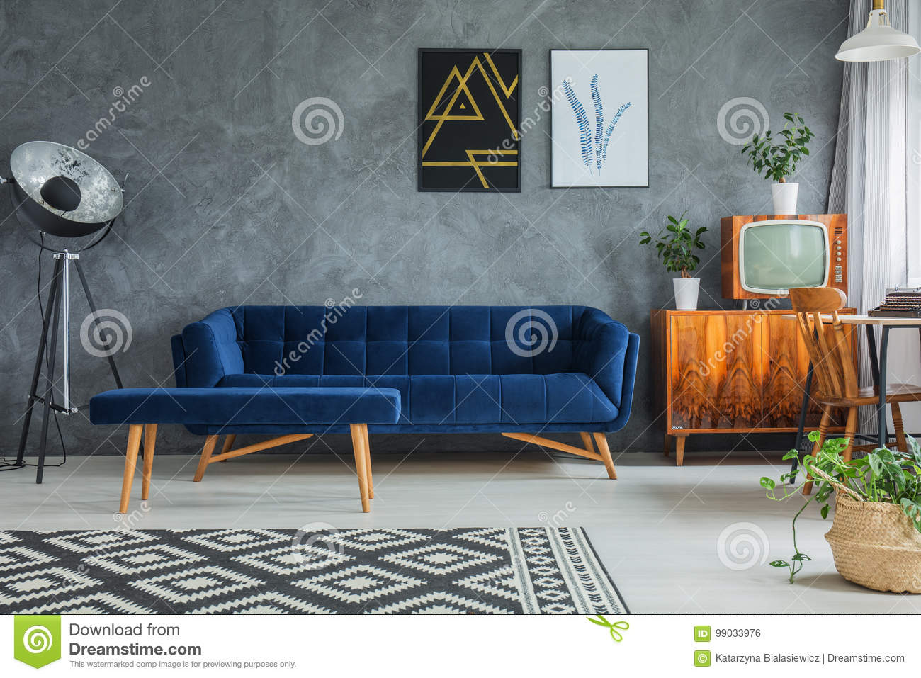 Dark Blue Comfy Couch With Matching Footrest And Wooden Cupboard With Retro  TV