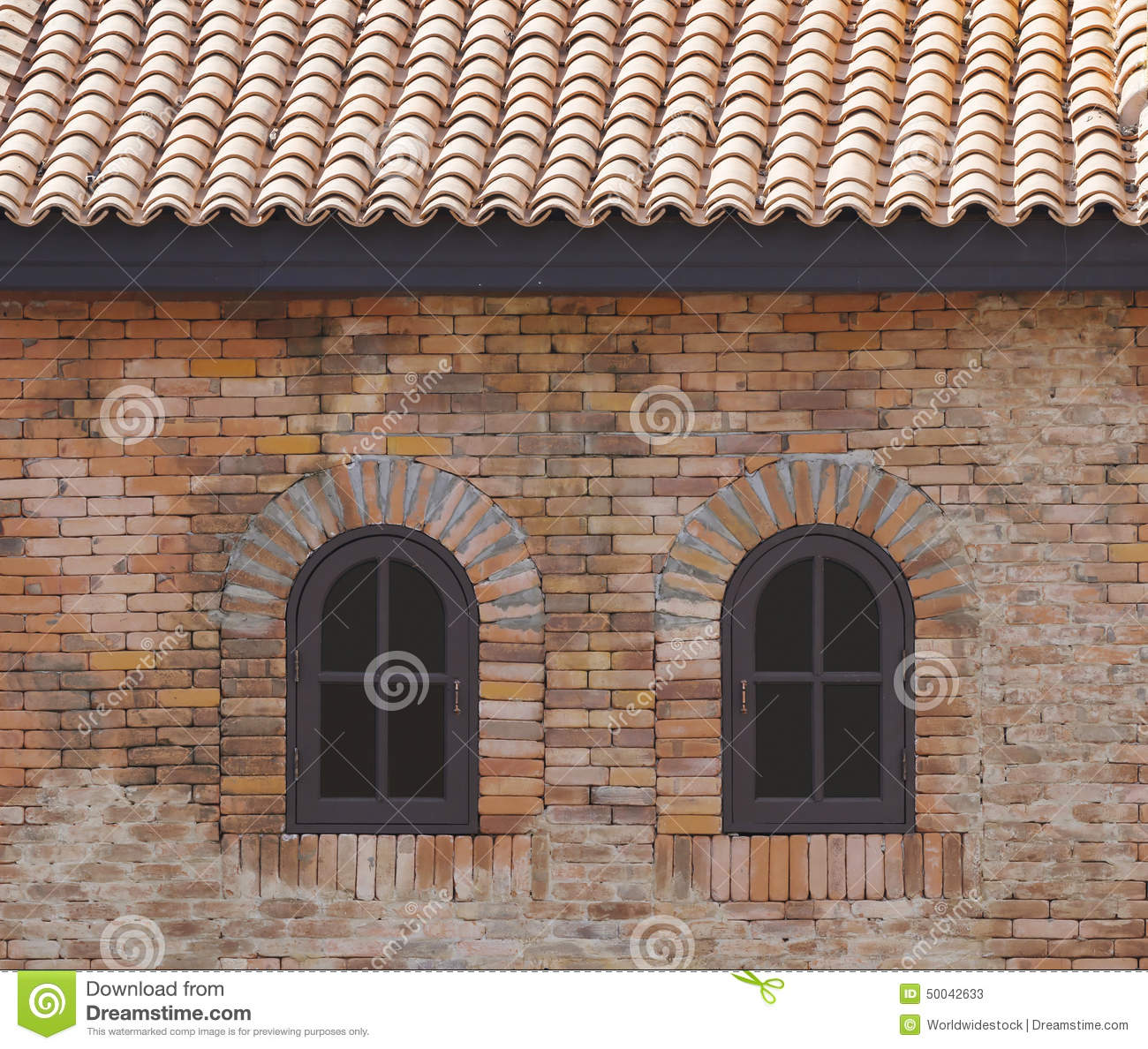 dark brown arched window in a brick wall stock image image of