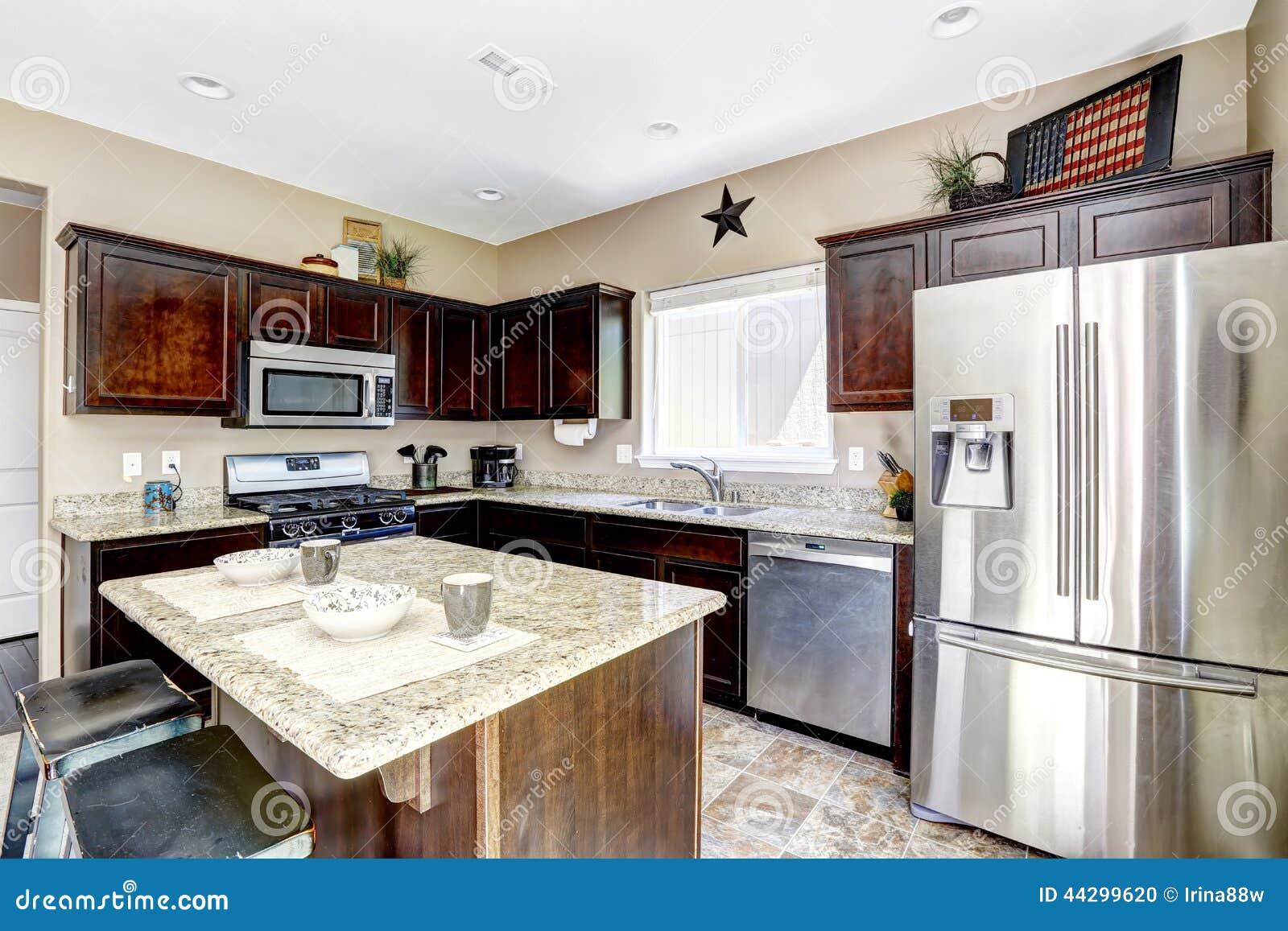 new home kitchen interior with dark brown cabinets stock photo