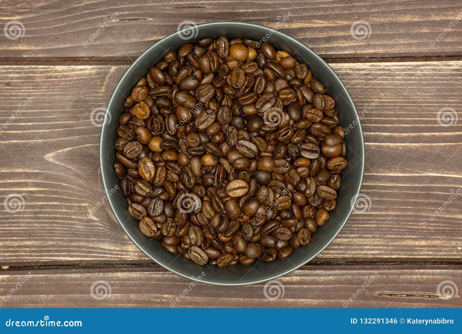 Dark Brown Coffee Beans Sweet Arabica On Brown Wood Stock Photo