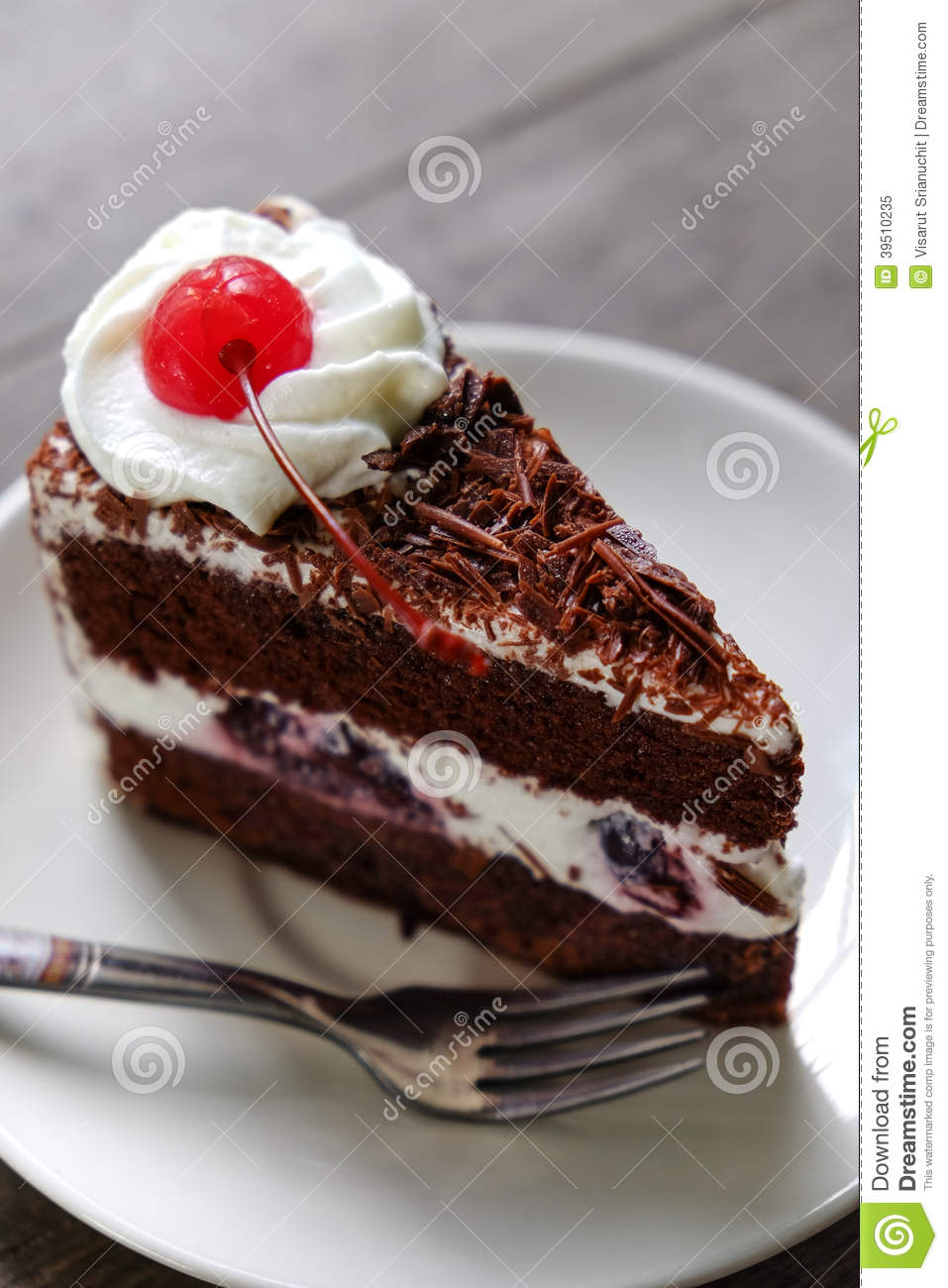 Dark chocolate cake on wood background
