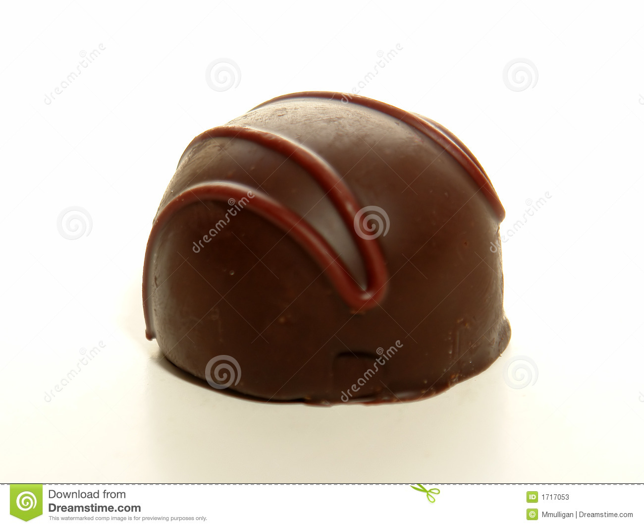 Delicious dark chocolate truffle on a white background.