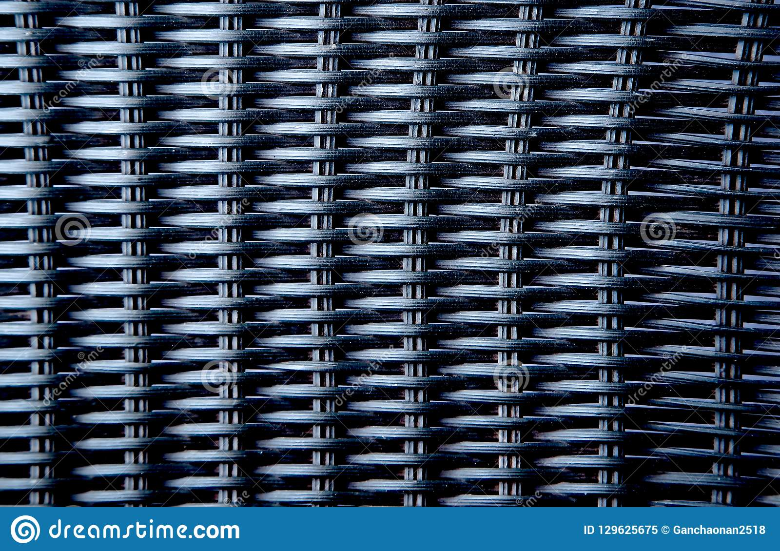 7ba4192f6f922 Dark color artificial rattan pattern. Background of basket structure  close-up.