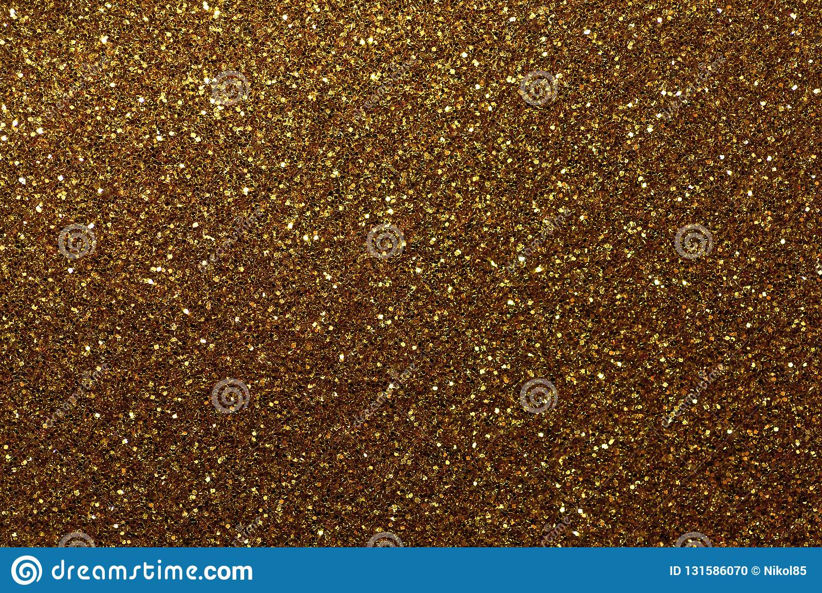 Dark golden sparkling background from small sequins, closeup. Brilliant shiny backdrop from textile. Shimmer bronze paper