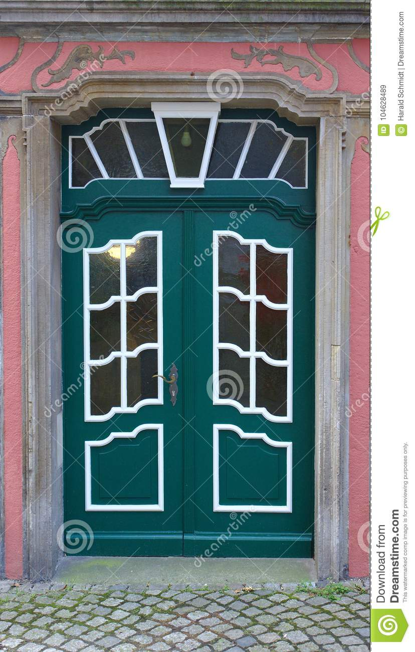 Dark Green Wooden Door With White Framed Window Panes Stock Image