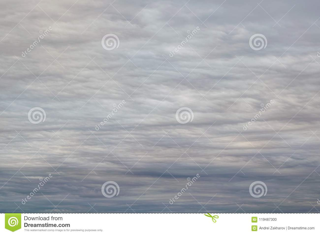 Dark, grey clouds covered the sky. Clouds in the form of lines and wavy layers.