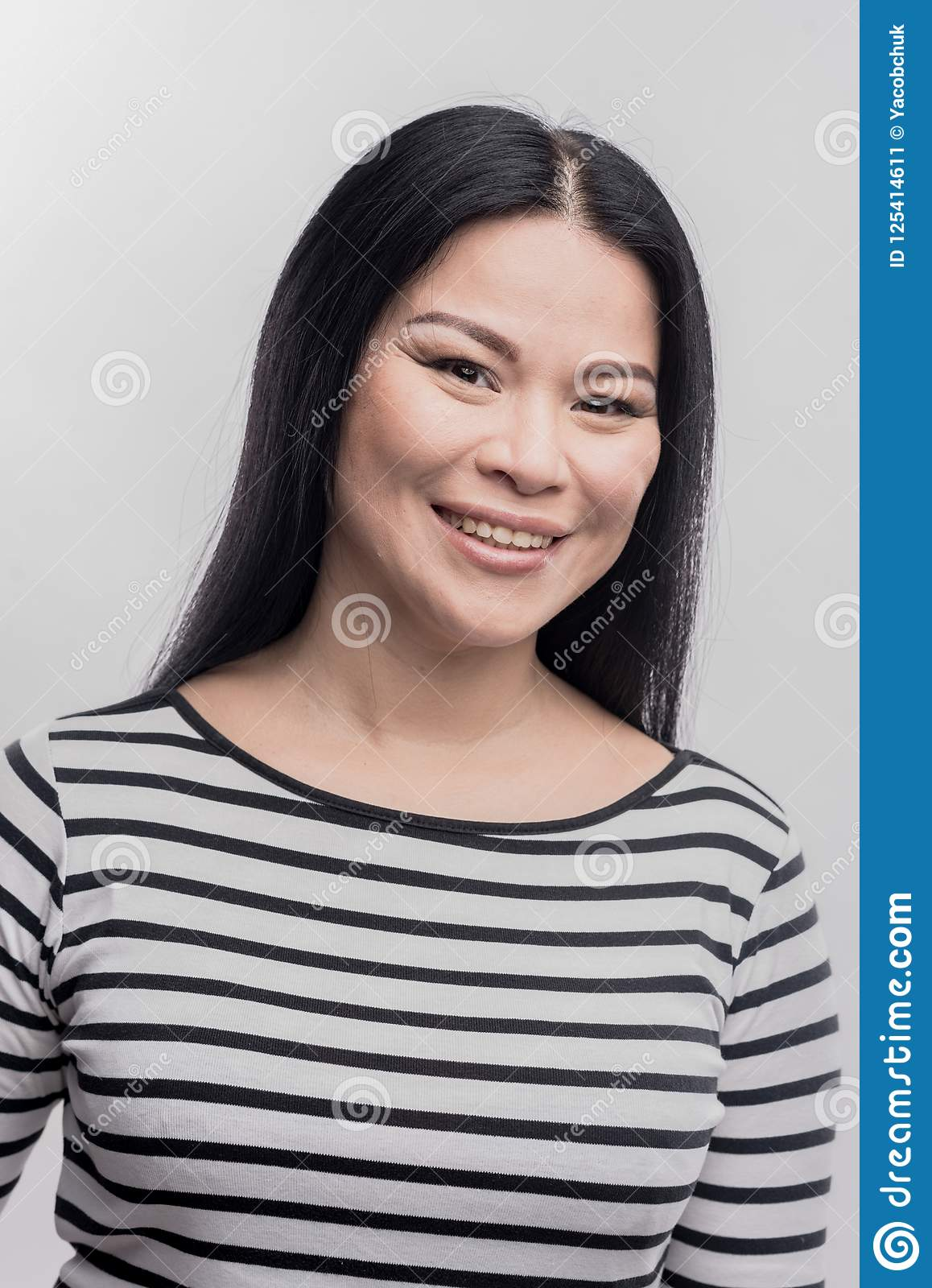 79a0a544b7a Dark-haired Smiling Woman Wearing Black And White Striped Shirt ...